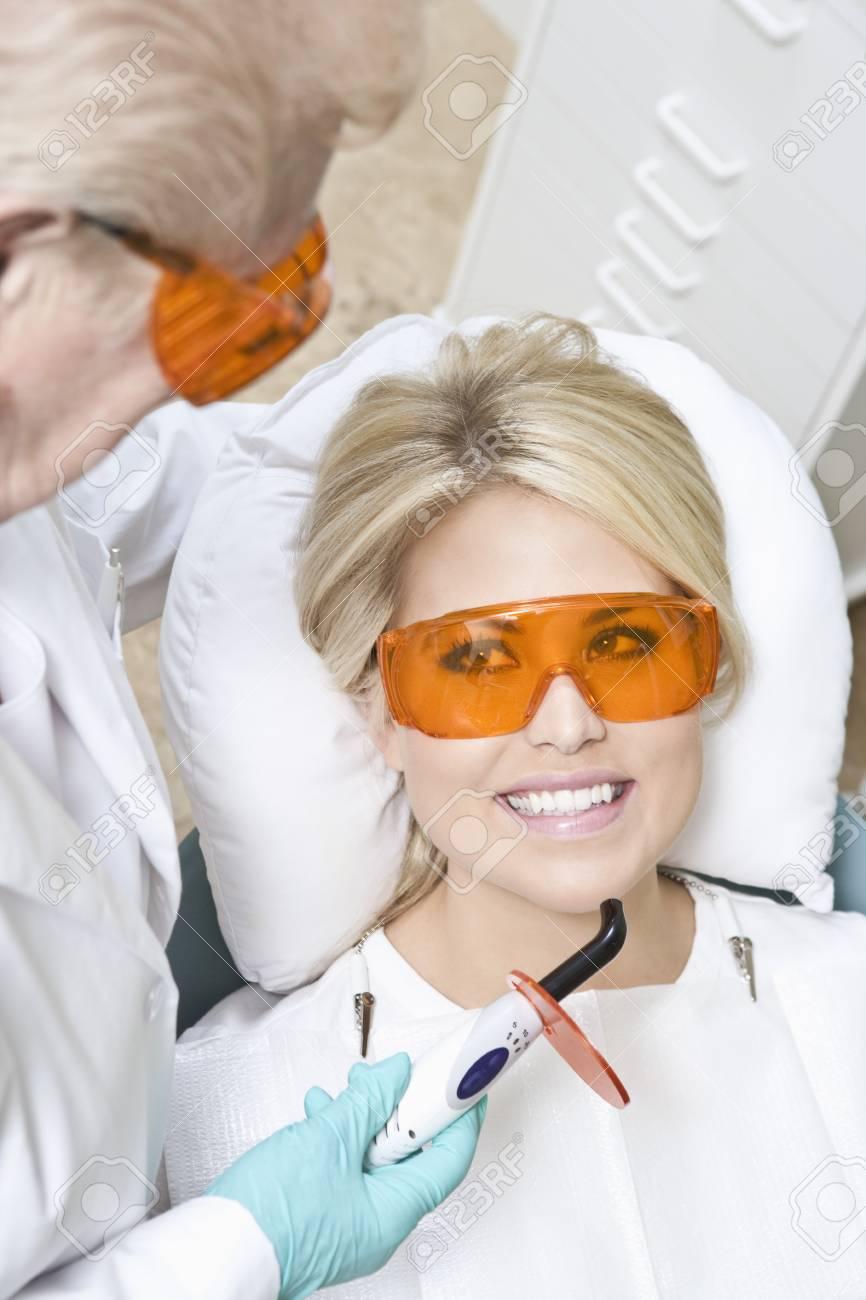 Dentist inspecting patient's teeth Stock Photo - 4925979