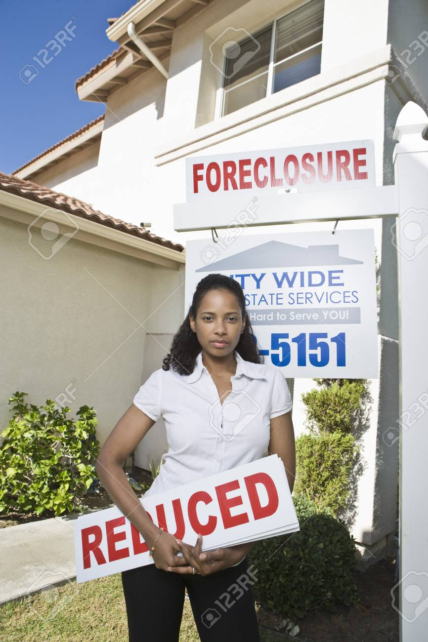 Woman holing sign outside house Stock Photo - 4926070