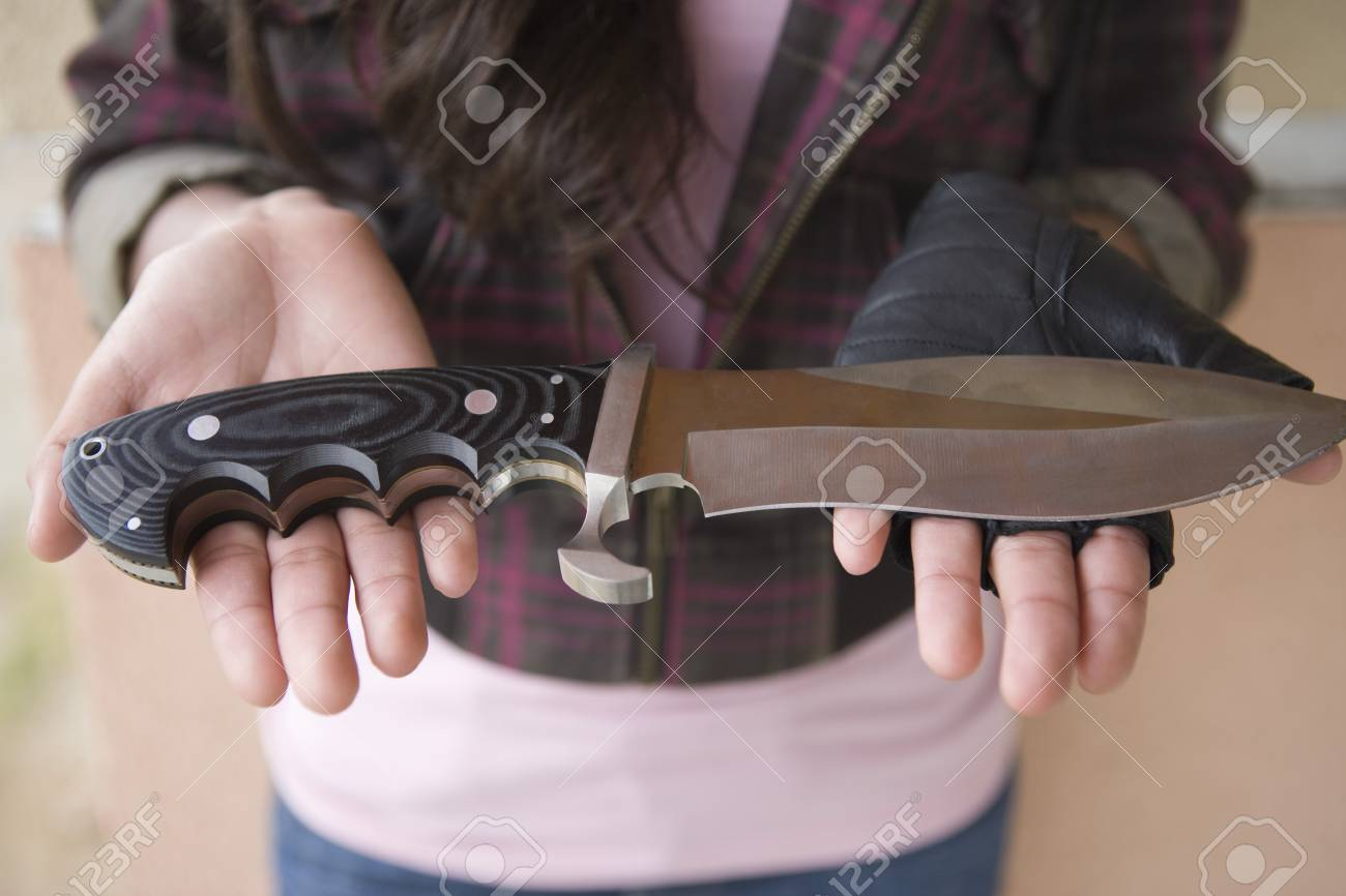 Young woman holding knife on her palms Stock Photo - 4926139
