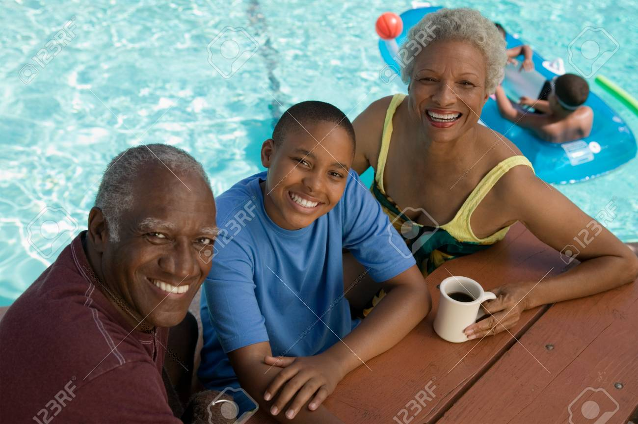 Grandparents and Grandson Sitting Poolside Stock Photo - 5404688