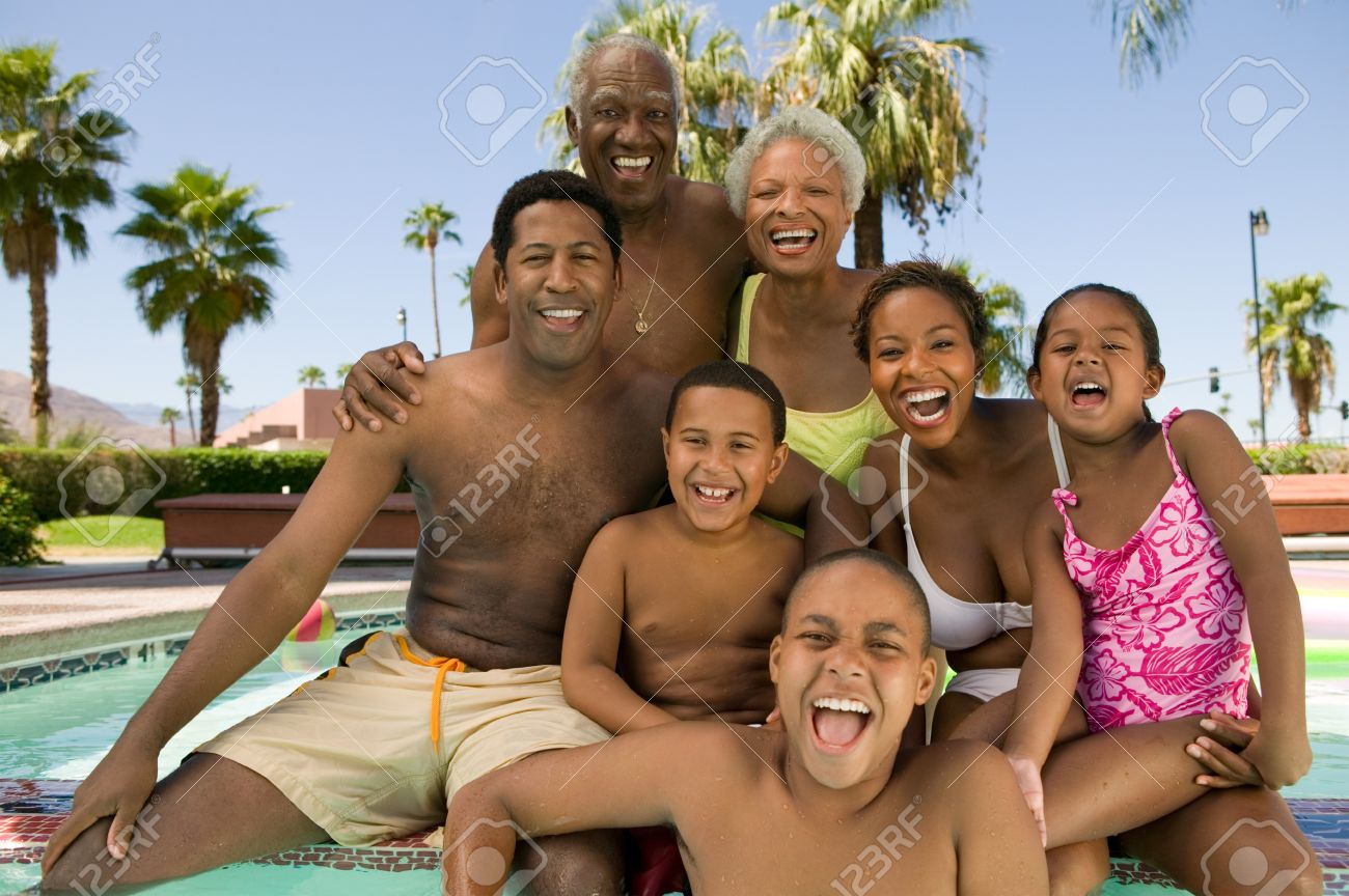 Family Relaxing Poolside Stock Photo - 5404700