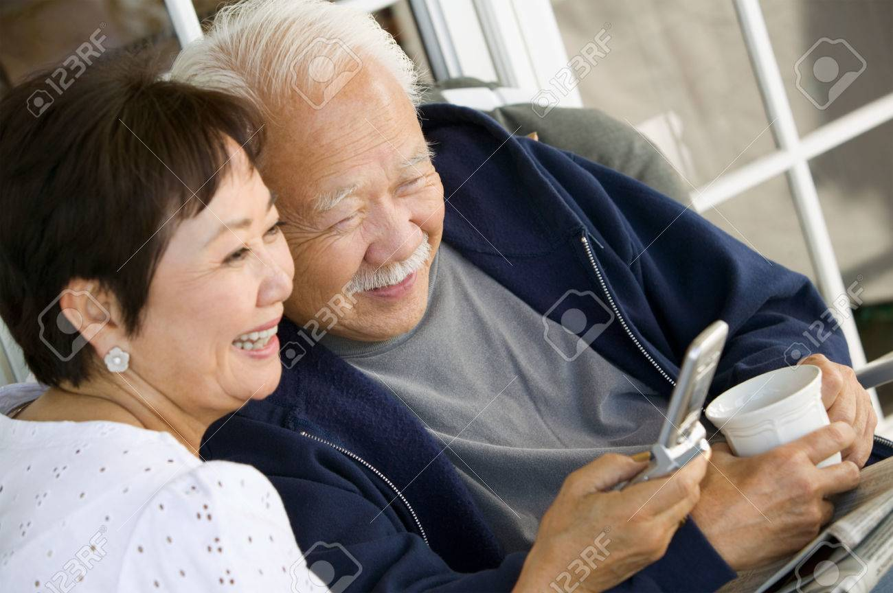 Couple Using Cell Phone Together Stock Photo - 5412291