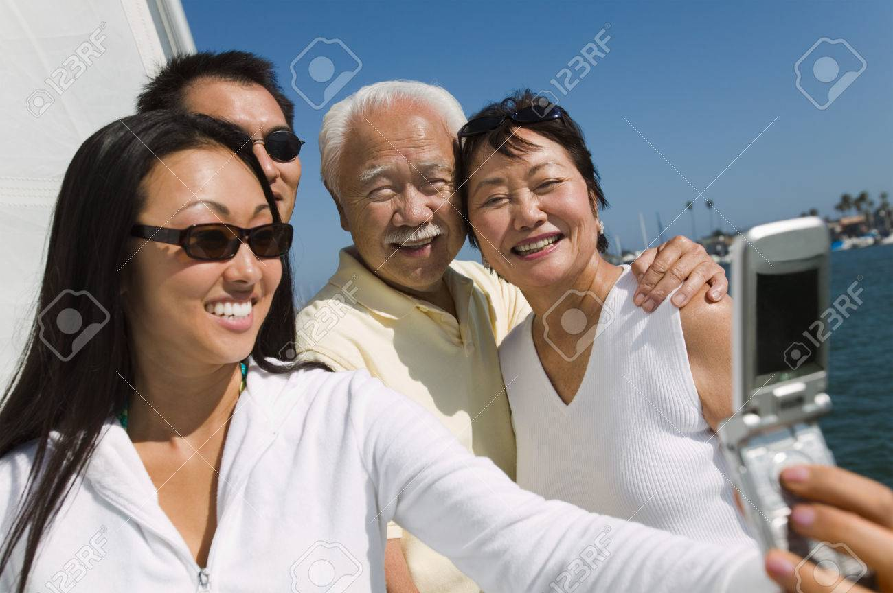Family on Sailboat Posing for Picture Stock Photo - 5412327