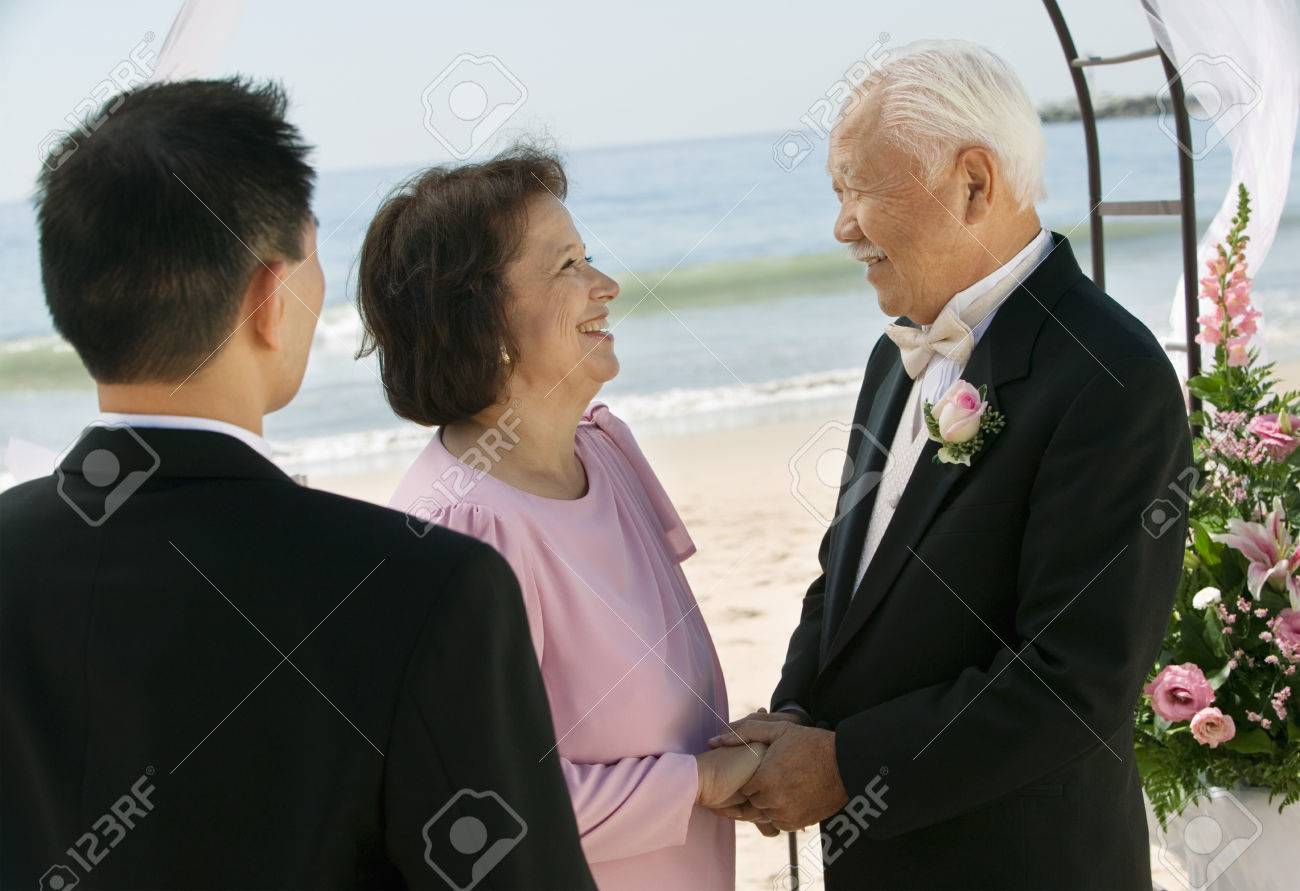 Groom With Parents on Beach Stock Photo - 5412422