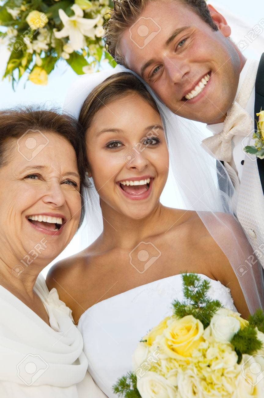 Bride and Groom With Mother on Beach Stock Photo - 5412452