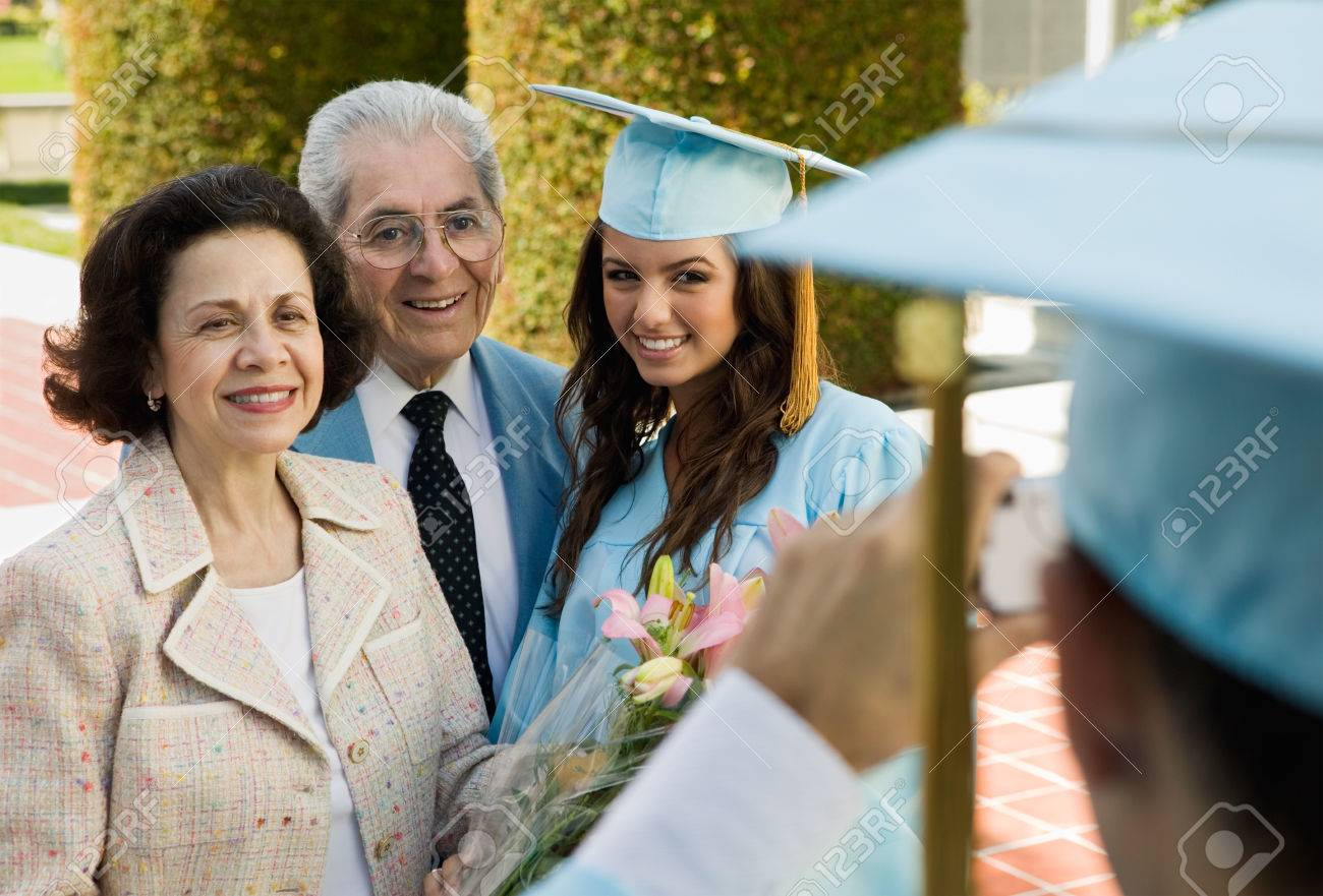 Graduate Posing for Picture with Parents Stock Photo - 5428455