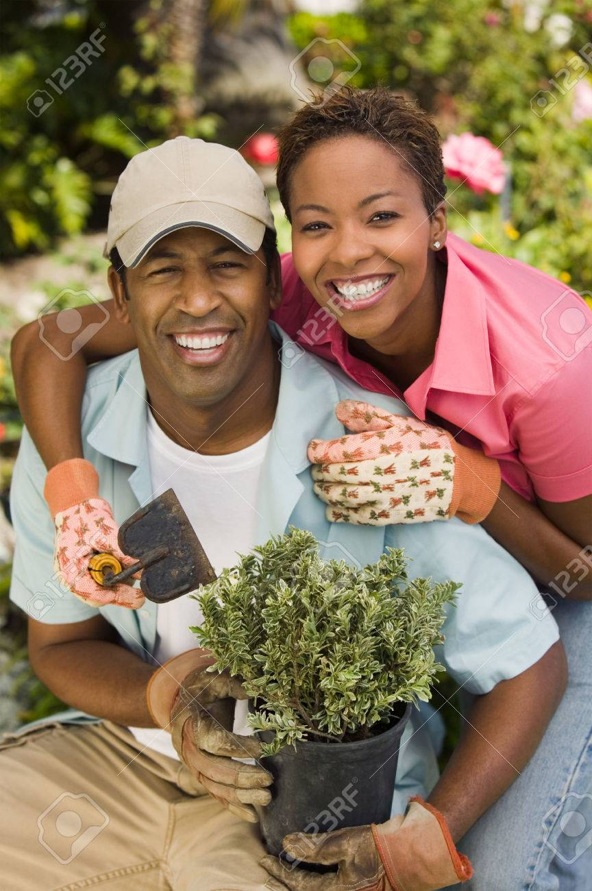Couple Working in Garden Together Stock Photo - 5435859