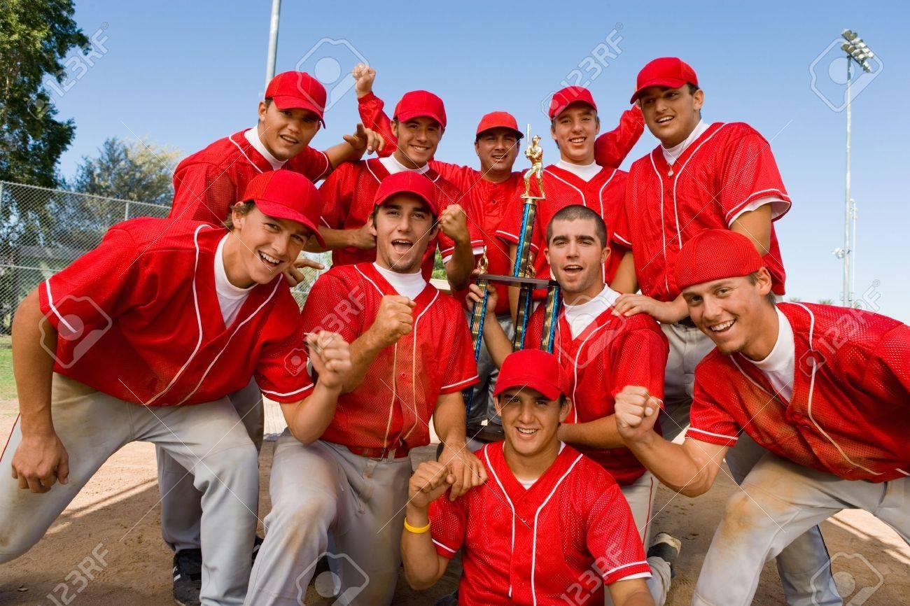 Teammates Holding Trophy Stock Photo - 5435911
