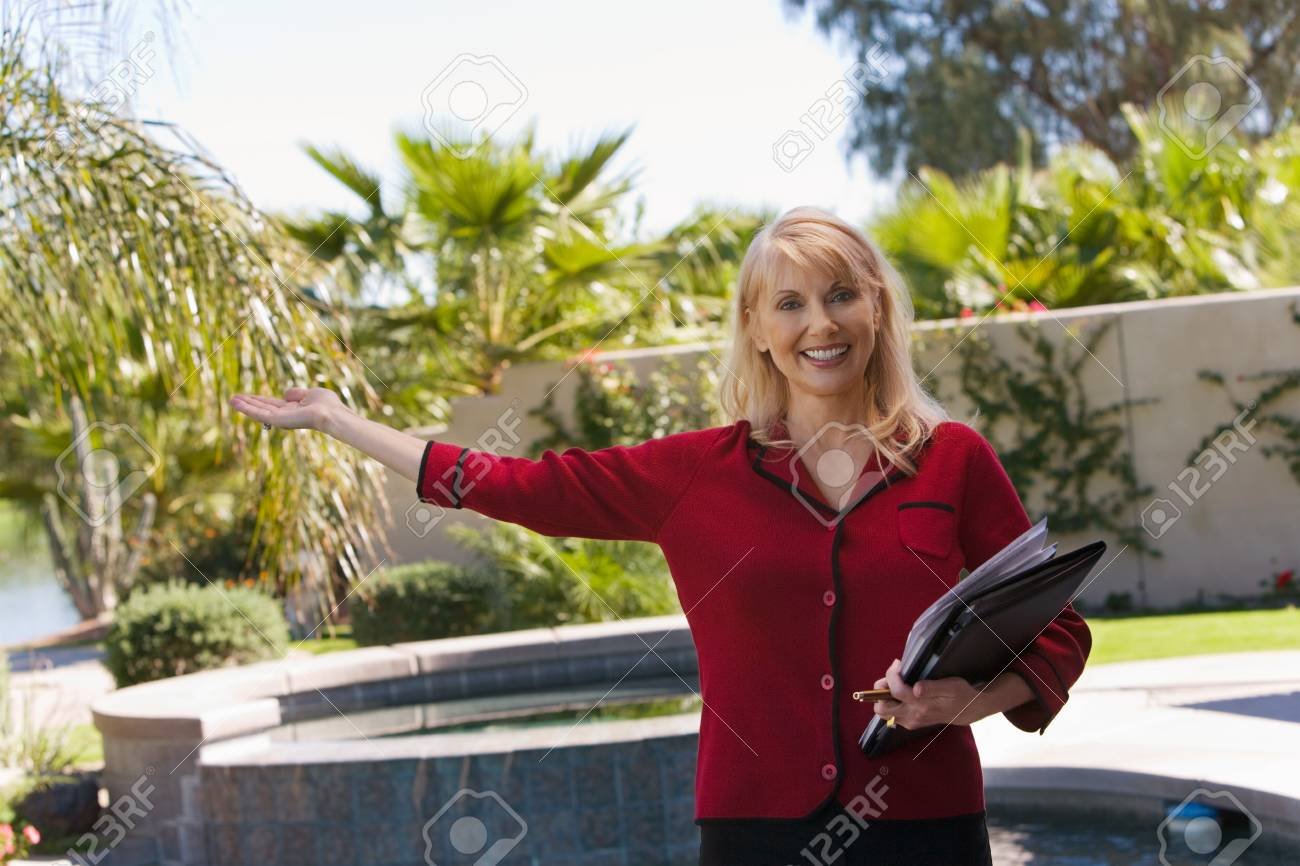 Real Estate Agent Showing Property Stock Photo - 5436118