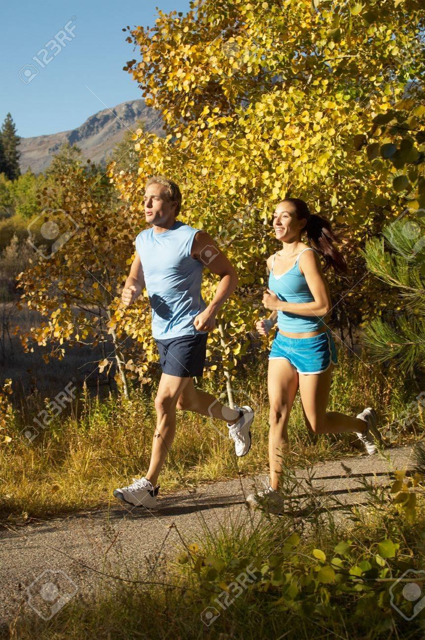 Jogging Couple on Scenic Path Stock Photo - 5436171
