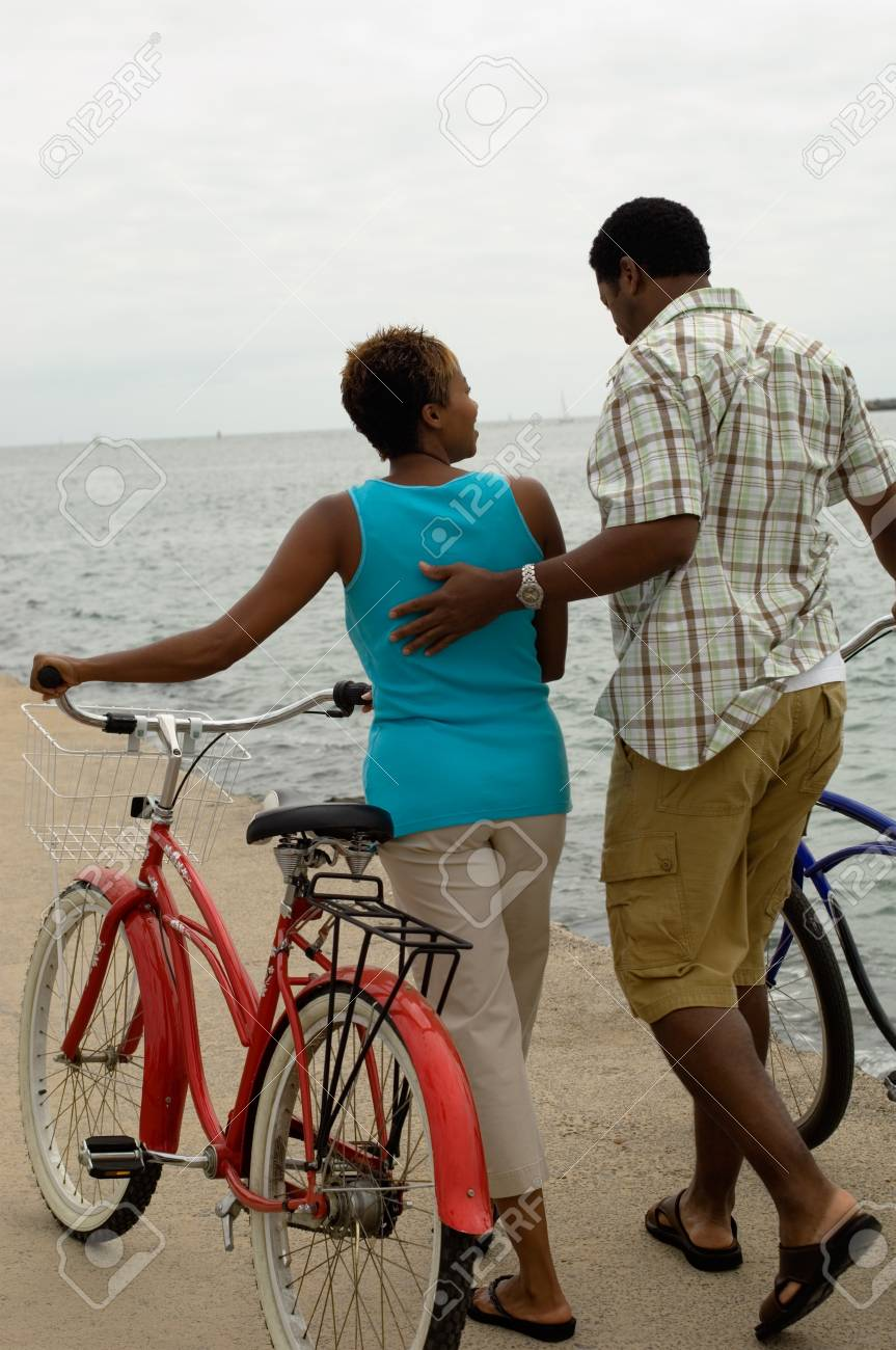 Couple With Bicycles at the Beach Stock Photo - 5436271