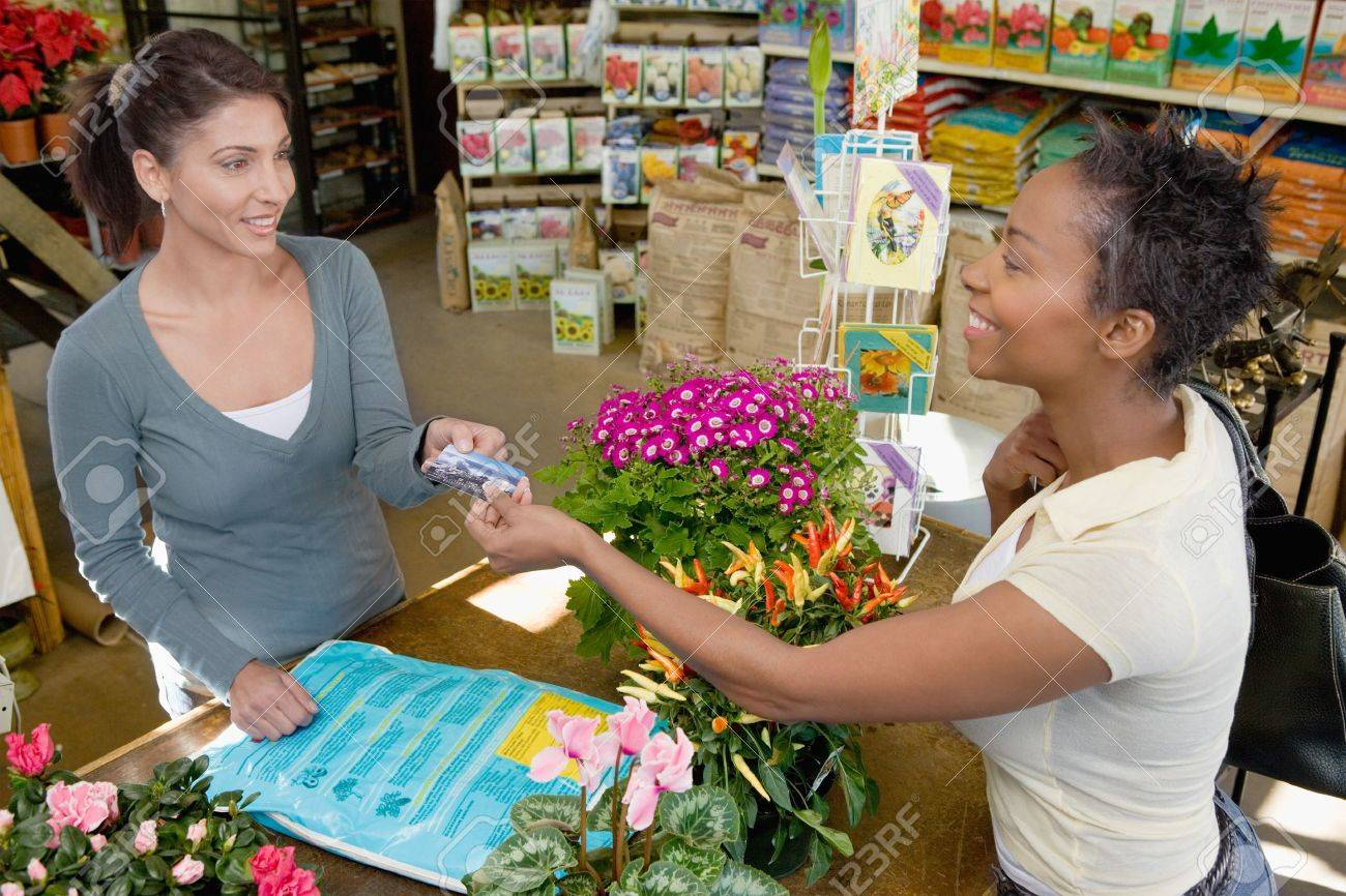 Woman Making a Purchase at Plant Nursery Stock Photo - 5438082