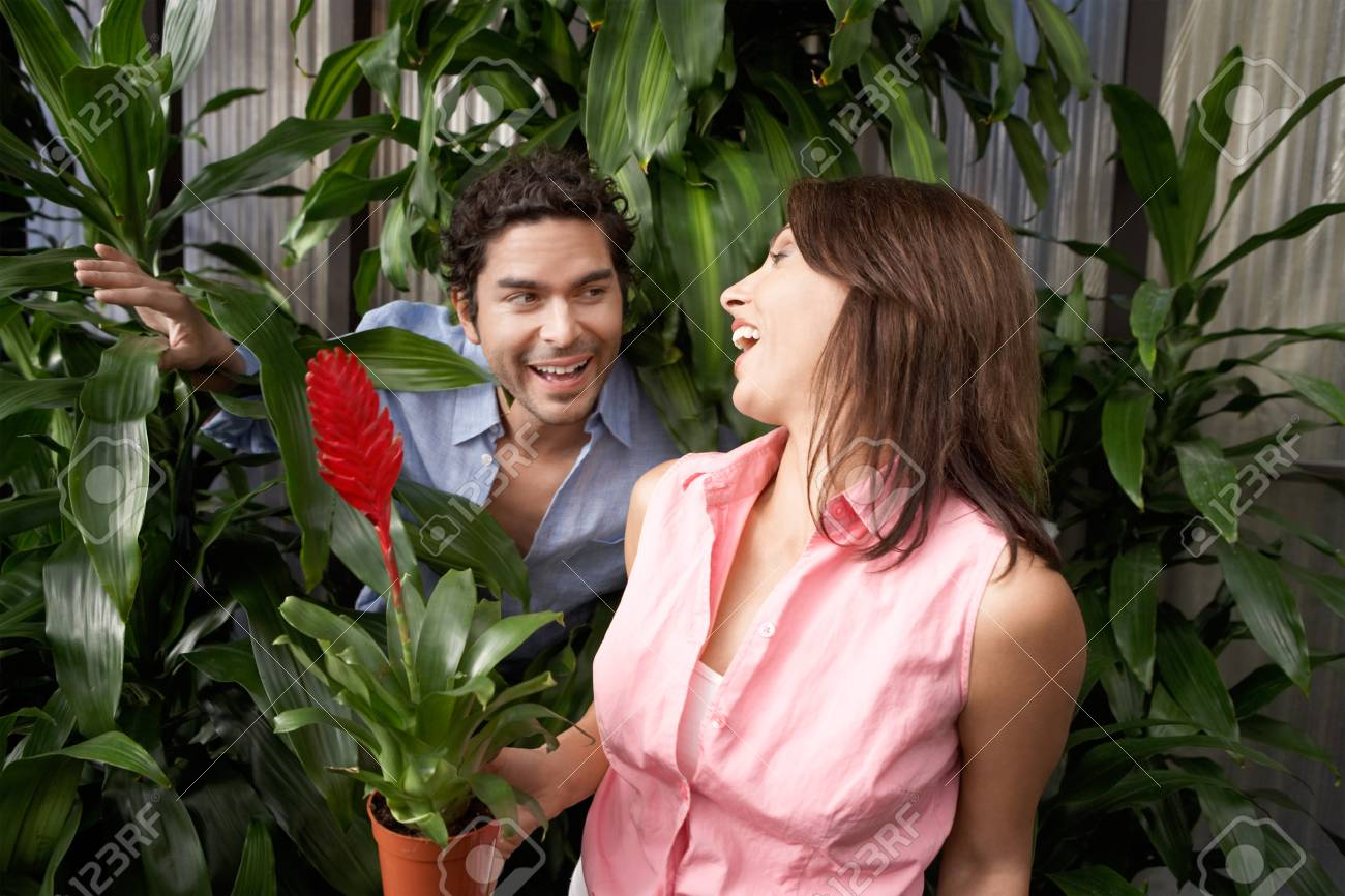 Playful Couple at a Plant Nursery Stock Photo - 5438088