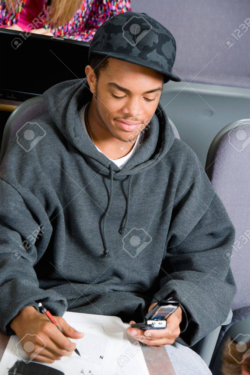 Student Using Cell Phone During Class Stock Photo - 5438110