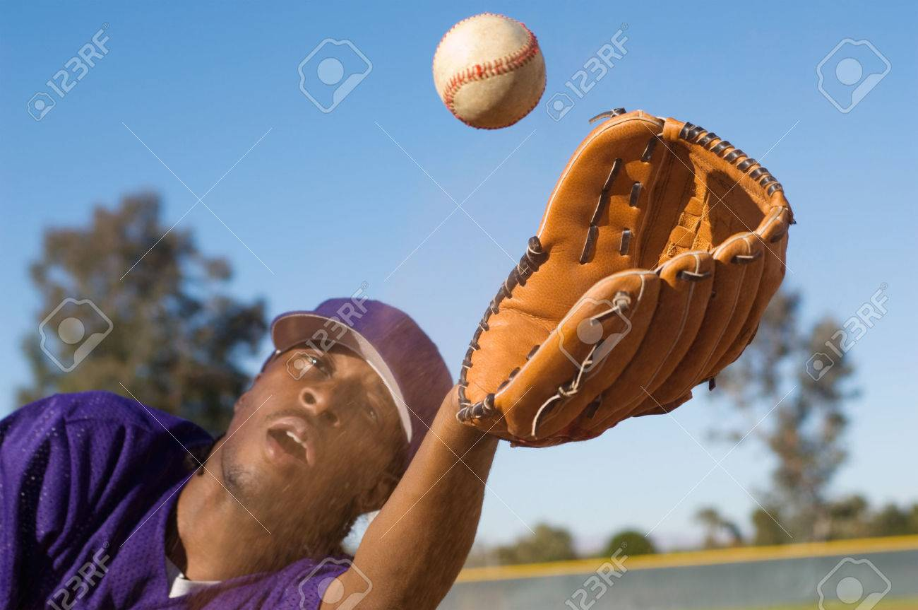 Baseball Outfielder Catching Fly Ball Stock Photo Picture And