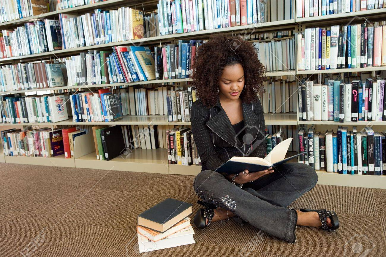 Young Woman at the Library Stock Photo - 5438246