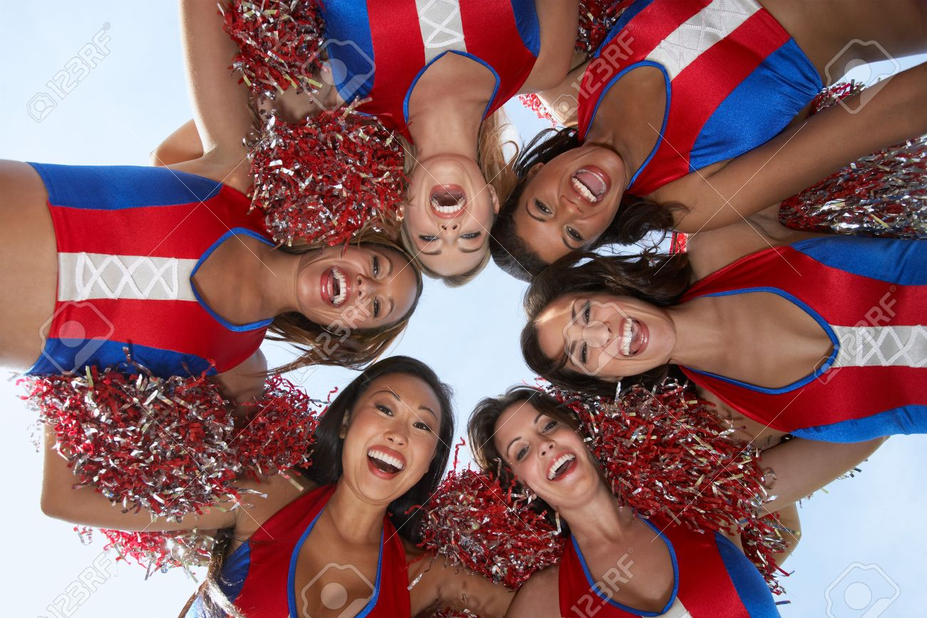 Cheerleaders in a Huddle Stock Photo - 5404499