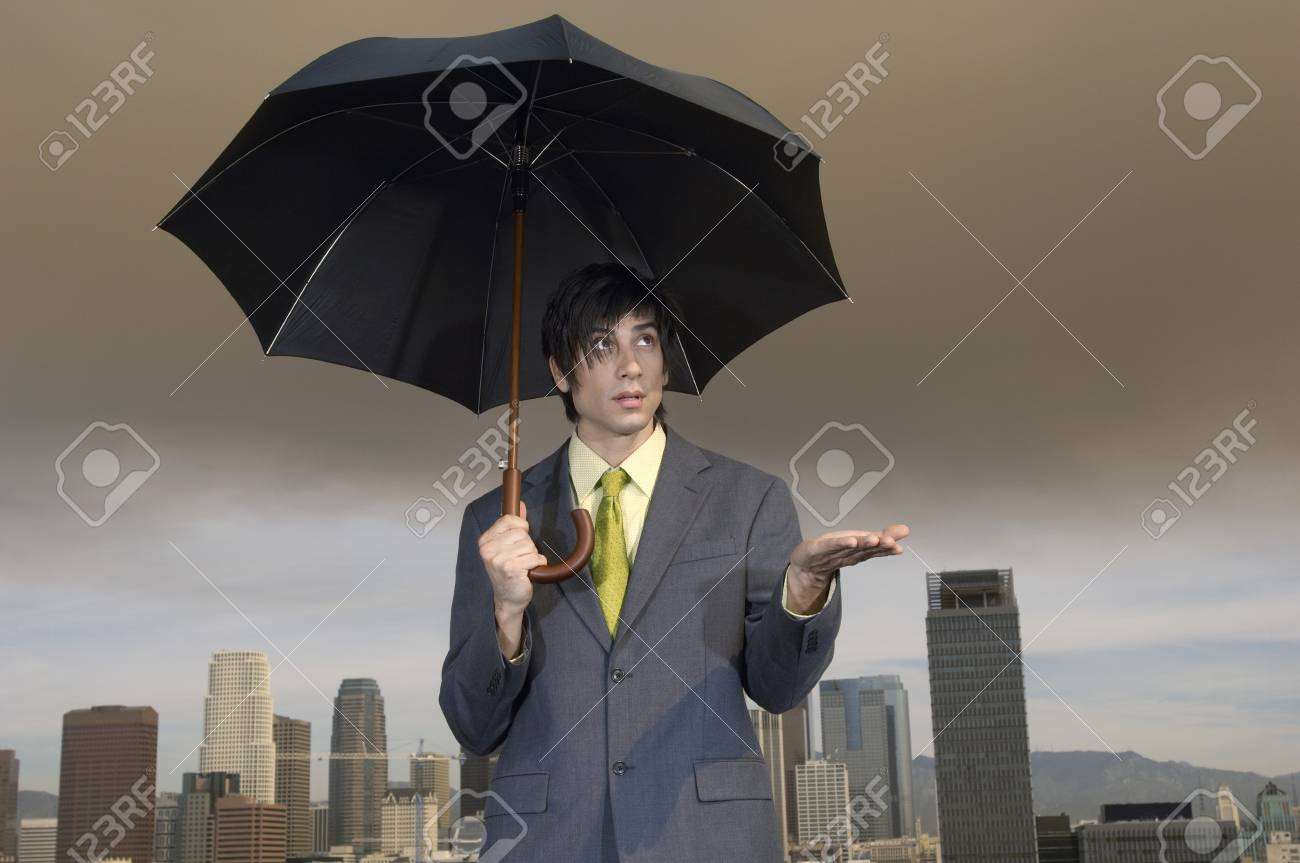 Businessman with Umbrella Stock Photo - 5438297