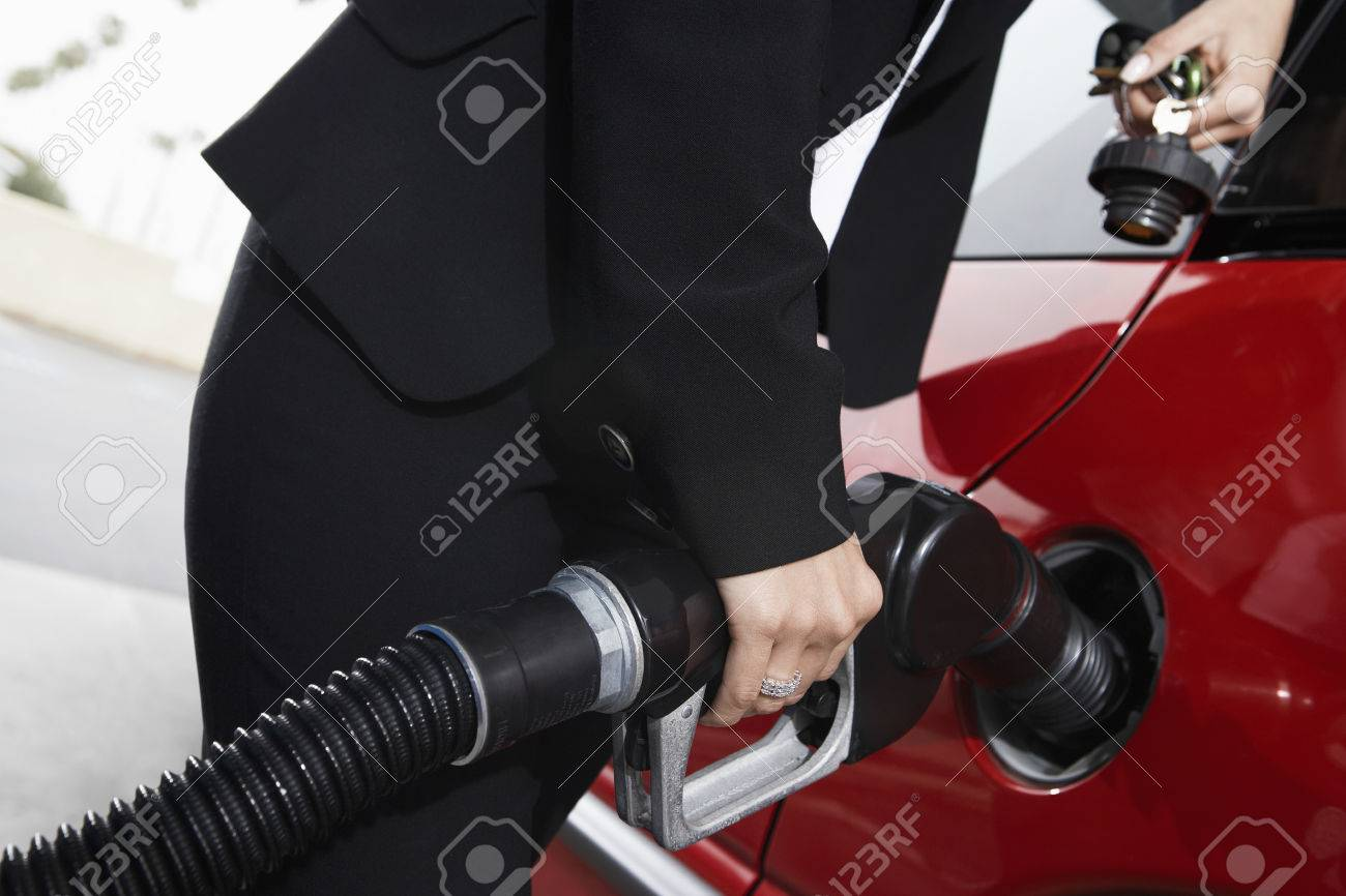 Businesswoman Filling Up at the Gas Station Stock Photo - 5438397