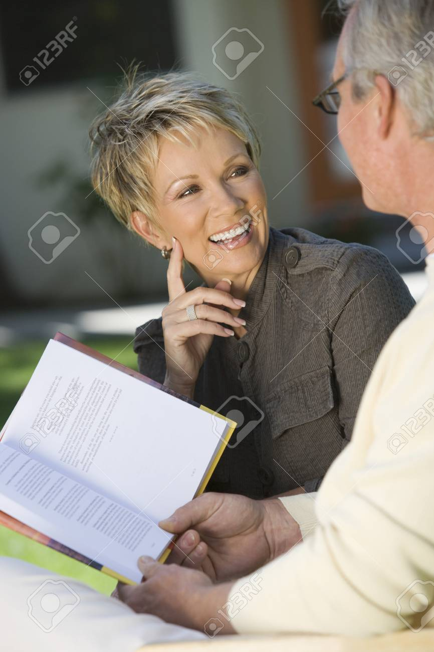 Couple smiling outdoors Stock Photo - 5459951