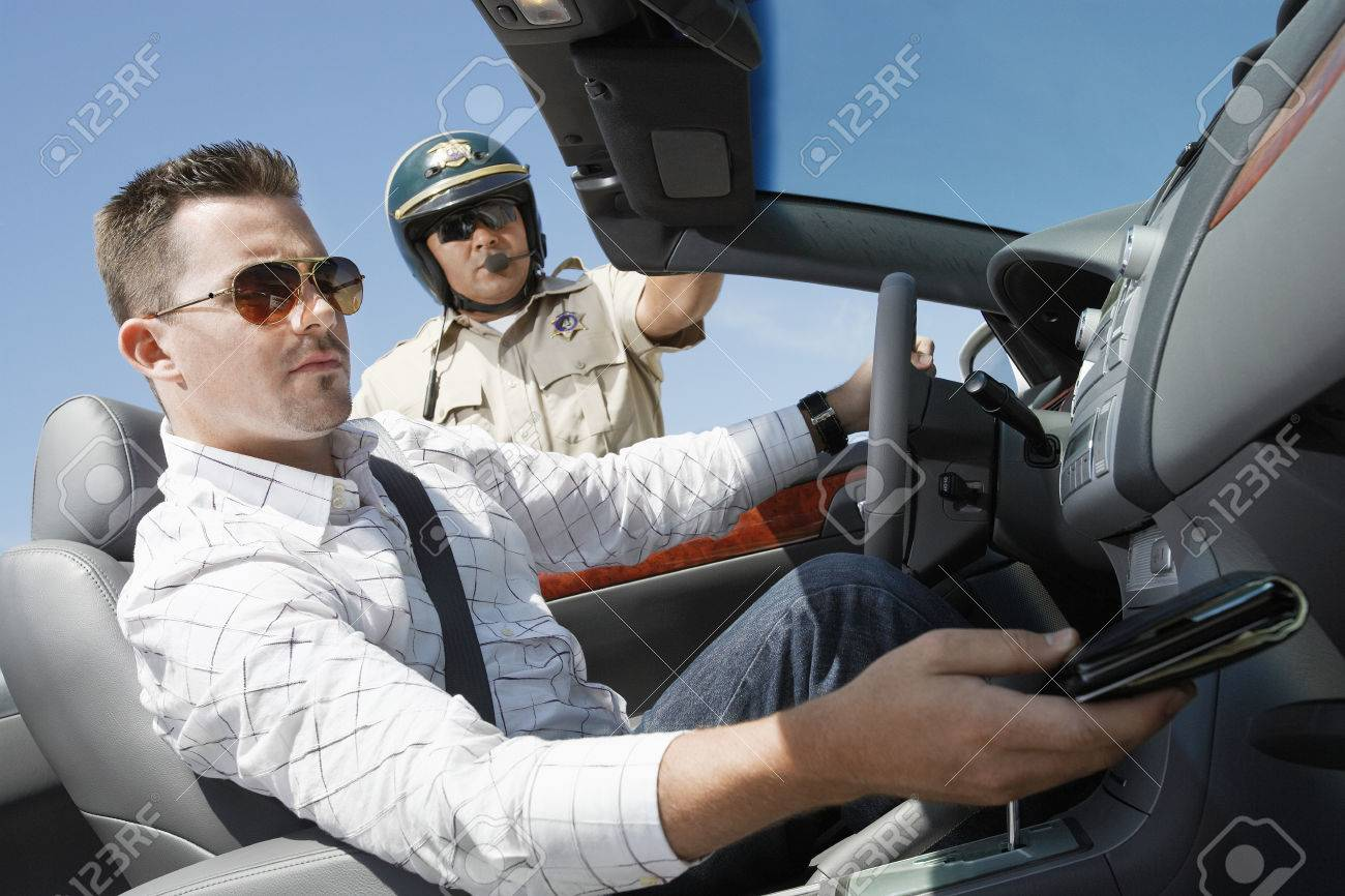 Police Officer Asking for Drivers License Stock Photo - 5460030