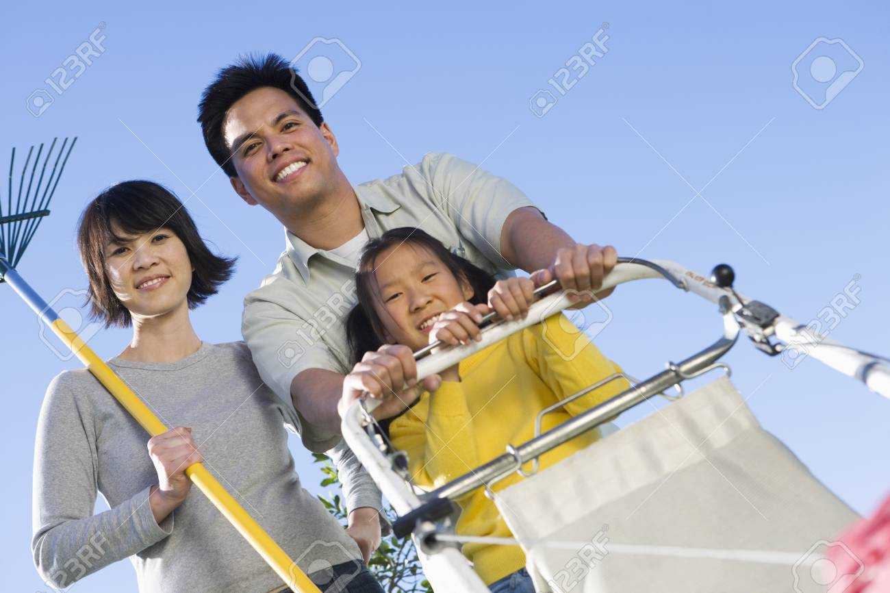 Family including girl (10-12) with garden equipment Stock Photo - 5460166