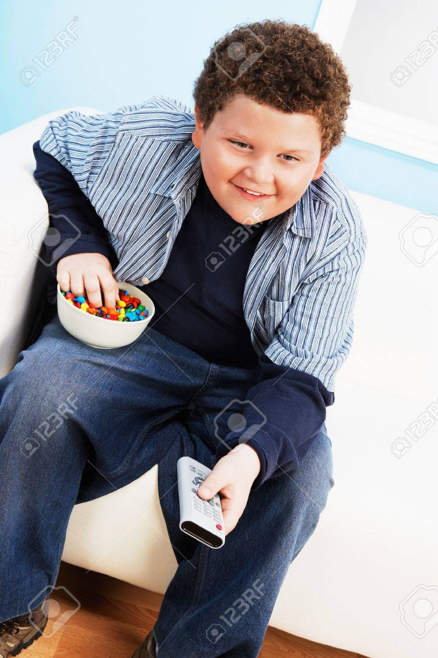 Overweight Child Eating Junk Food Stock Photo - 5438230