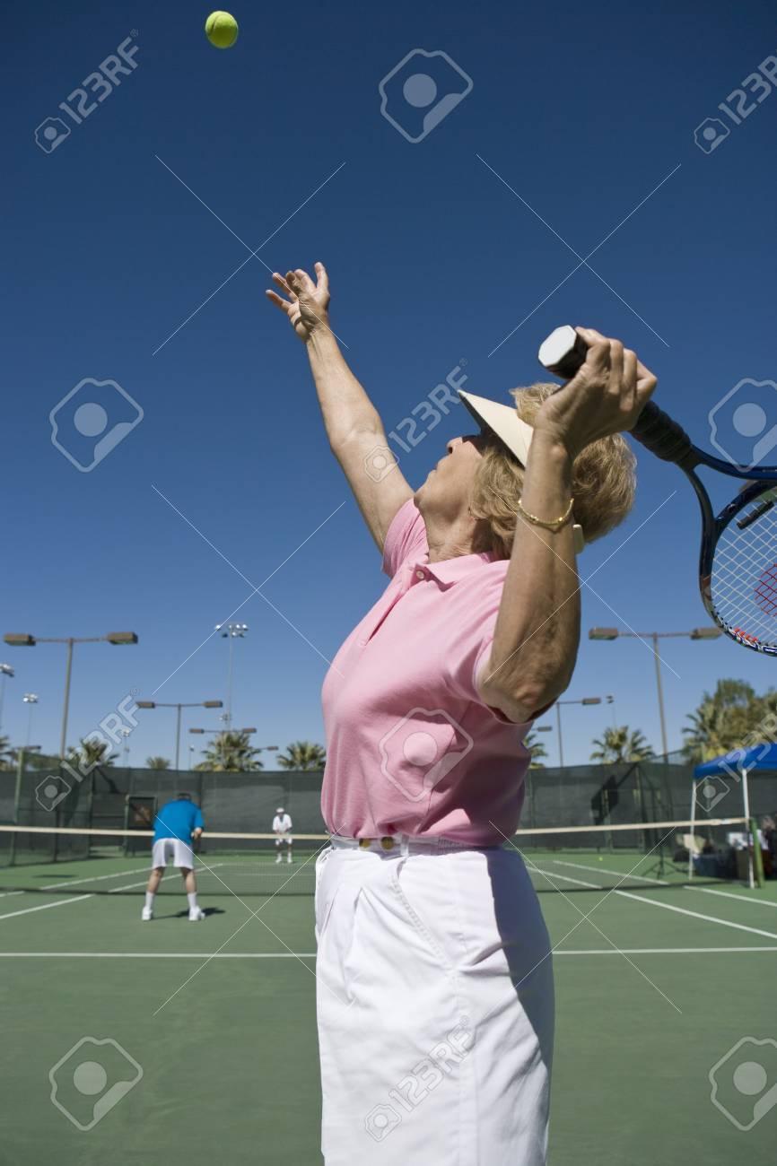 Senior woman playing tennis Stock Photo - 5470167