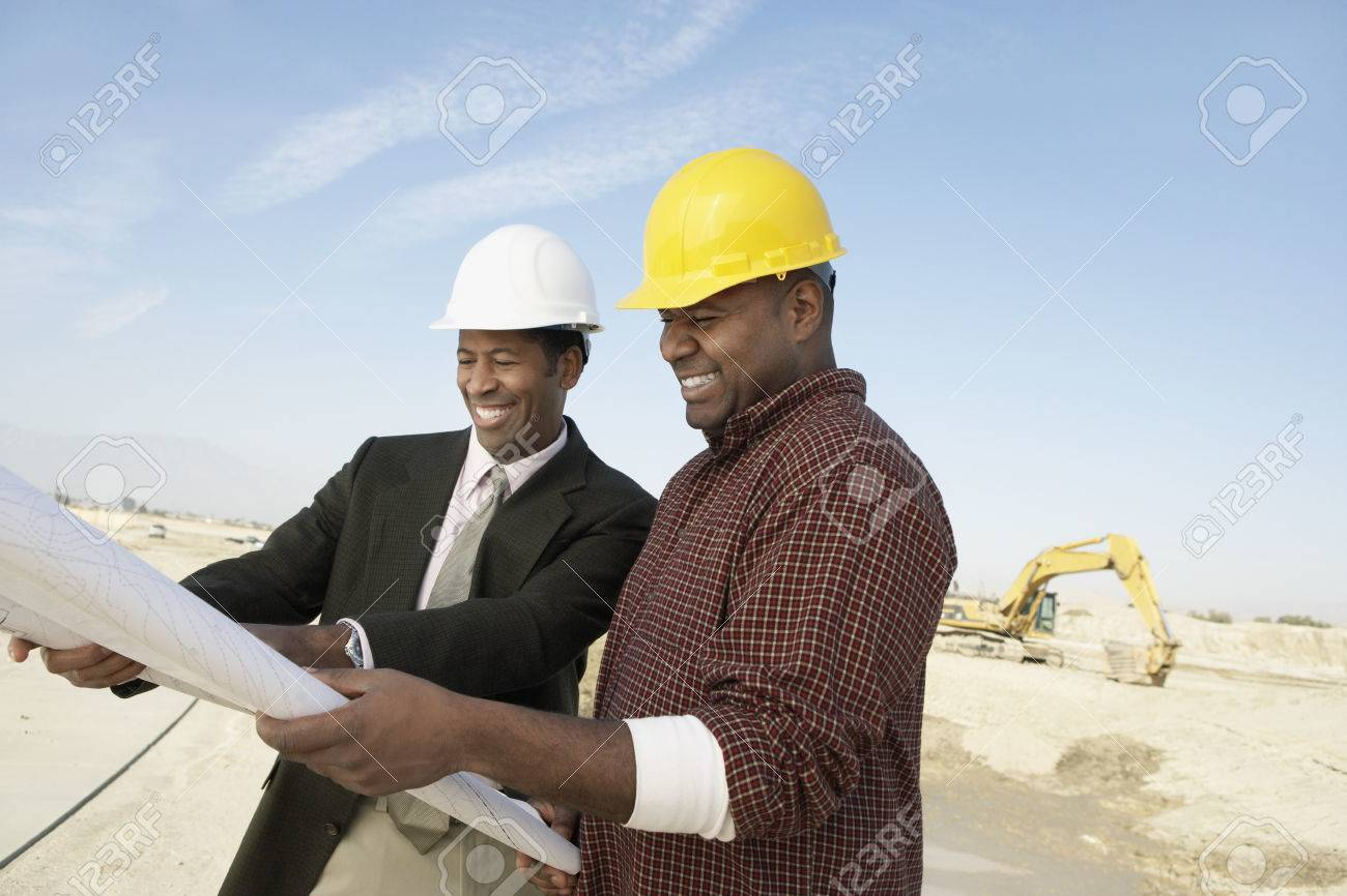 Surveyor and Construction Worker on Site Stock Photo - 5470220