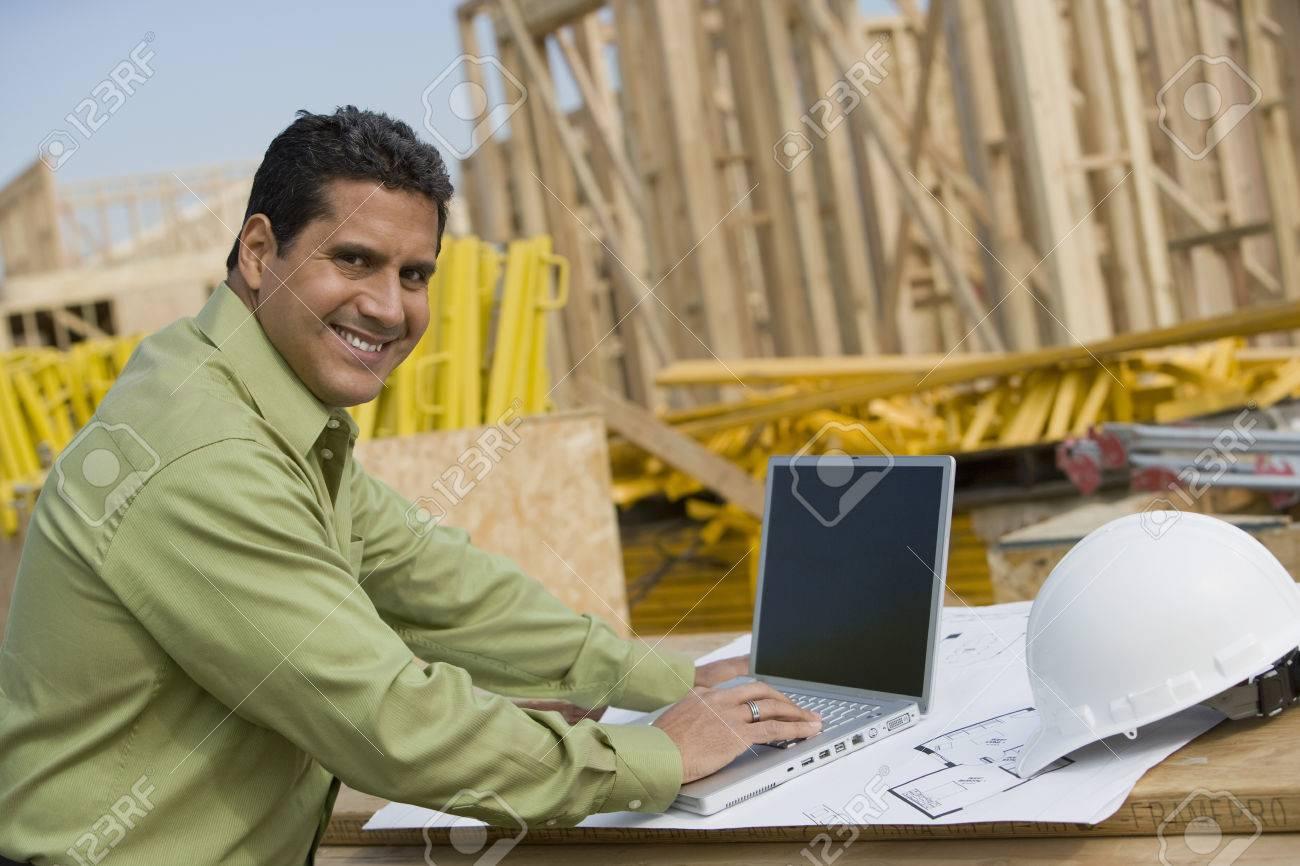 Construction worker using laptop, portrait Stock Photo - 5470254