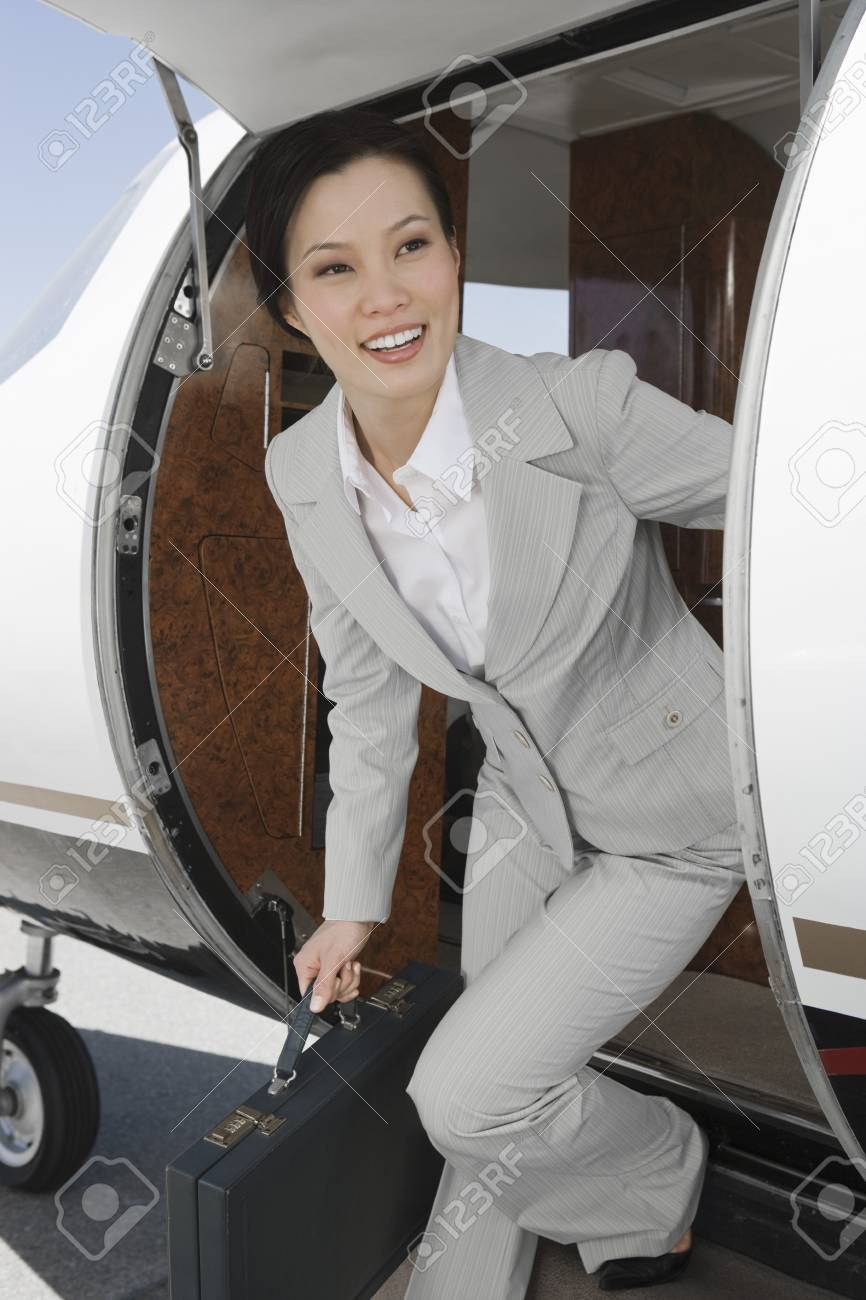 Asian businesswoman getting off private airplane. Stock Photo - 5474998