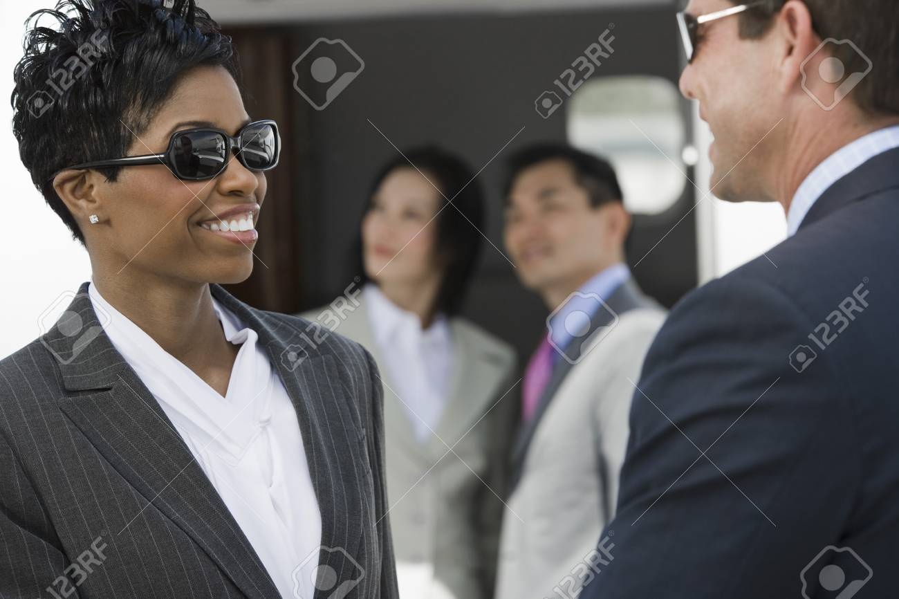 Mid-adult businesswoman and businessman talking. Stock Photo - 5475066