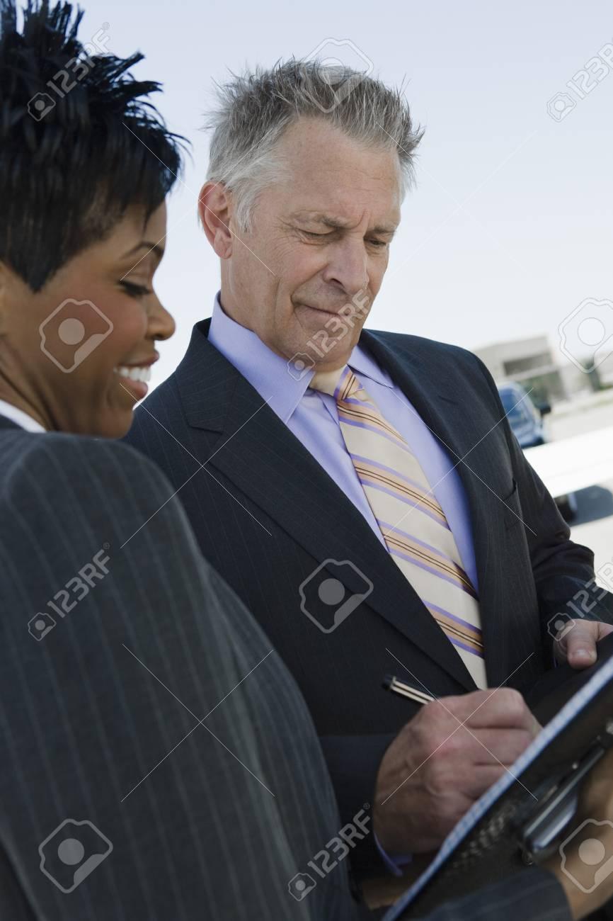 Senior businessman signing documents. Stock Photo - 5475074