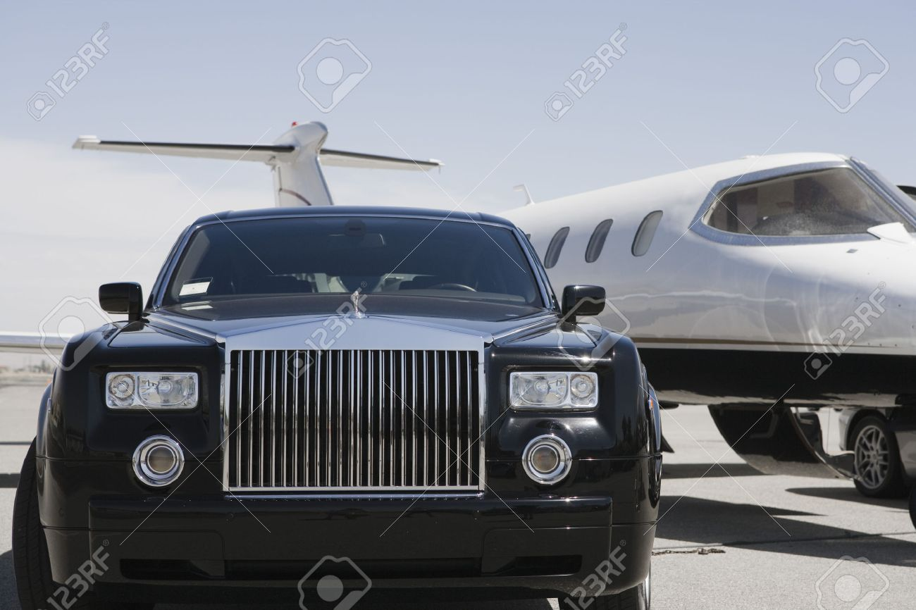 Limousine and private jet on landing strip. Stock Photo - 5475076
