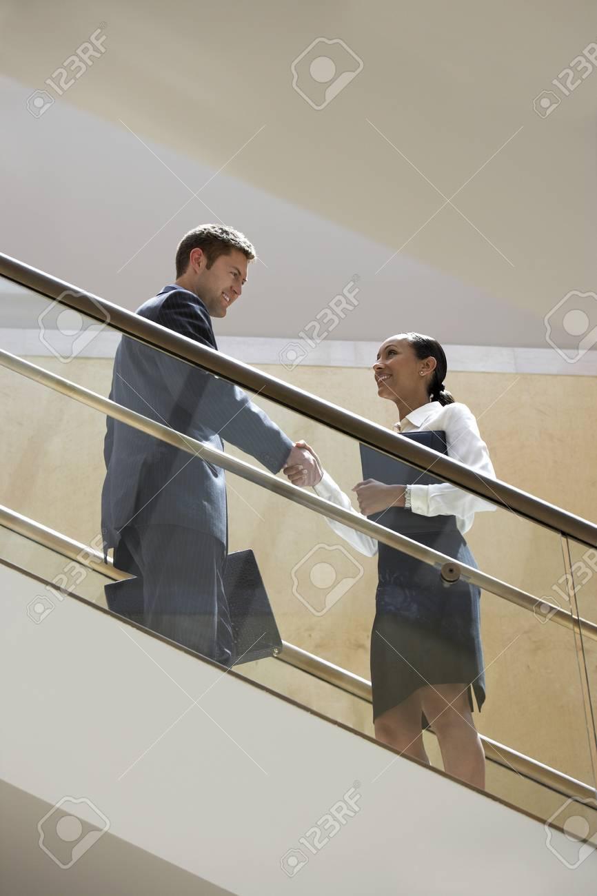 Businessman and Businesswoman on Escalator Stock Photo - 5475359