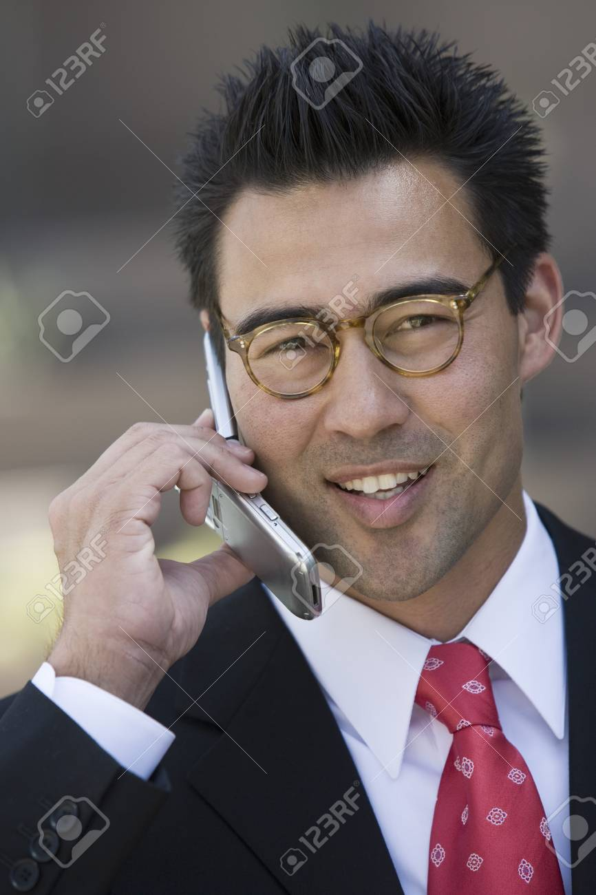 Business man using mobile phone, outdoors Stock Photo - 5475421