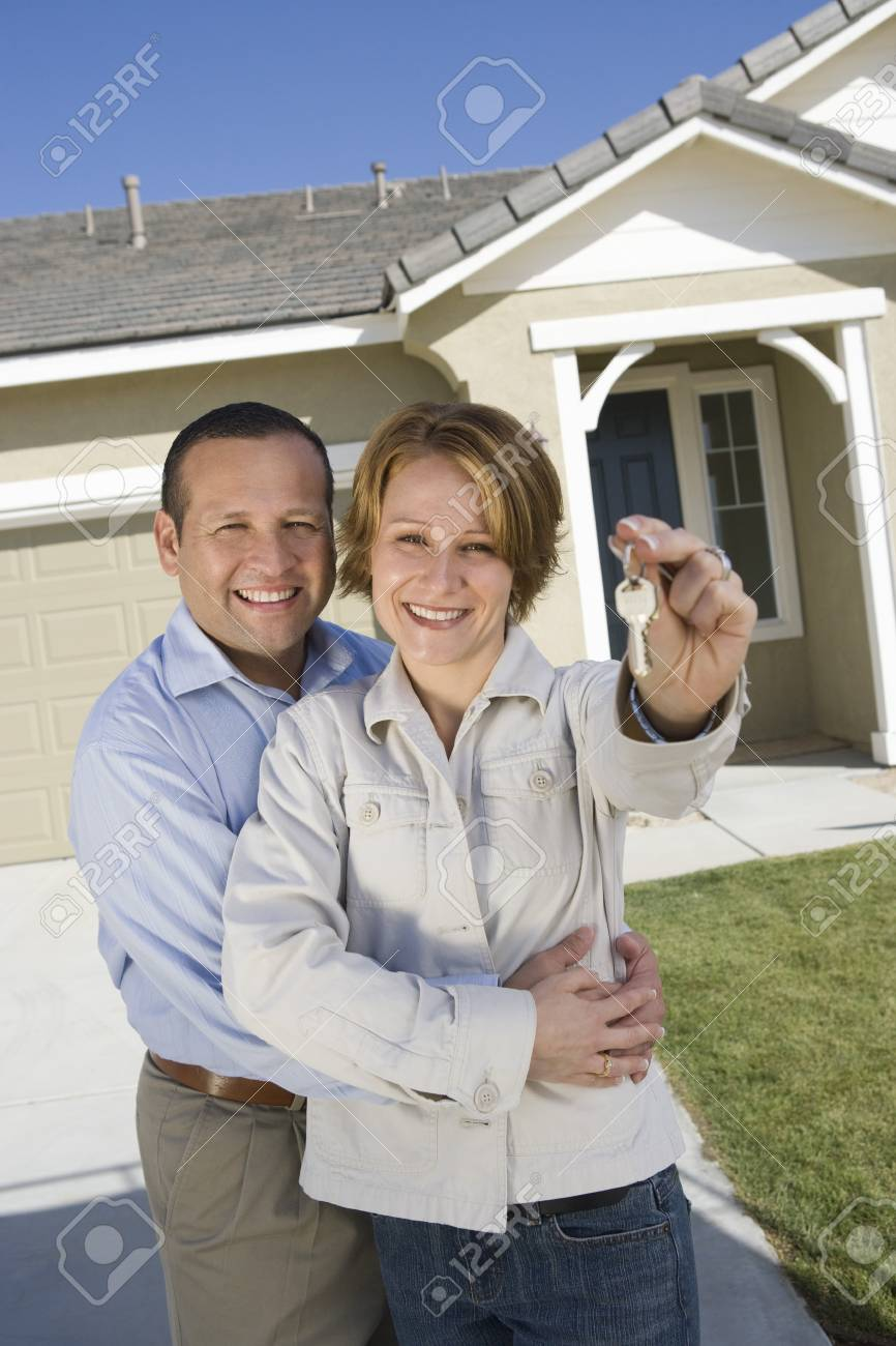 Portrait of mid-adult couple with keys to new house Stock Photo - 5475499