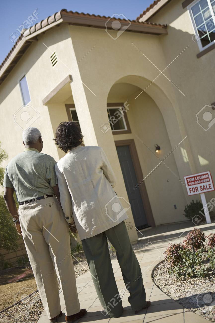 Middle-aged couple looking at newly build house, back view Stock Photo - 5412245