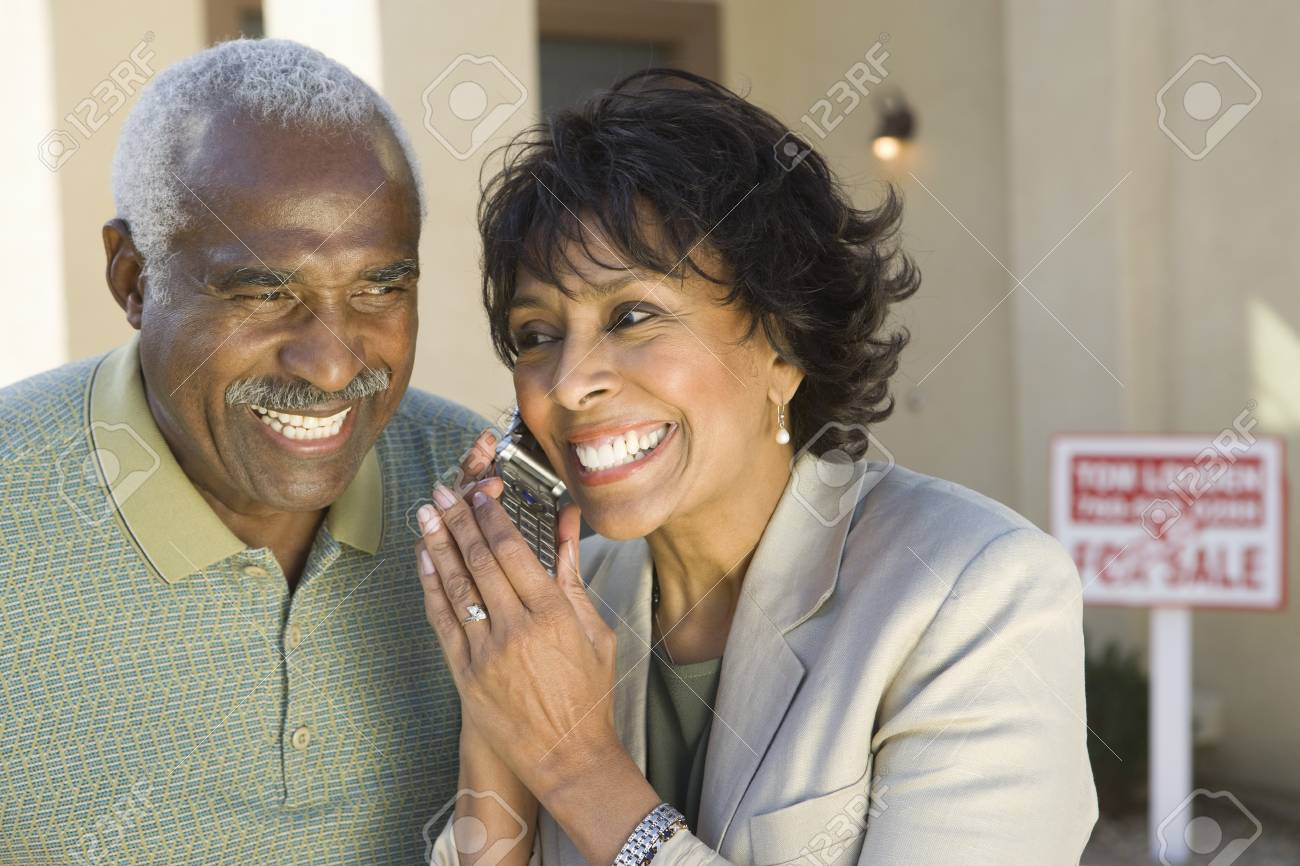Middle-aged couple in front of new home Stock Photo - 5412251
