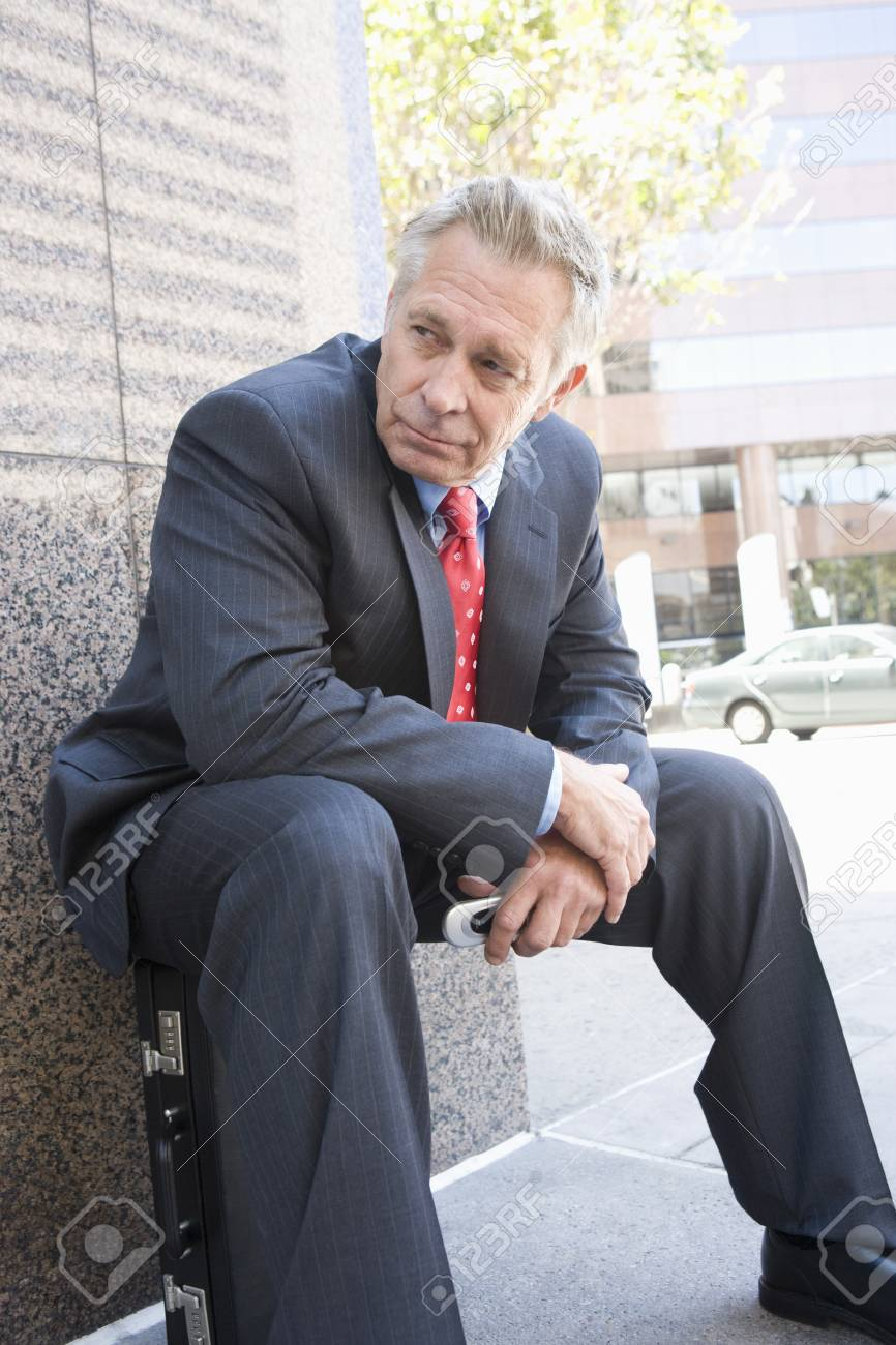 Middle-aged businessman relaxing outdoors Stock Photo - 5475586