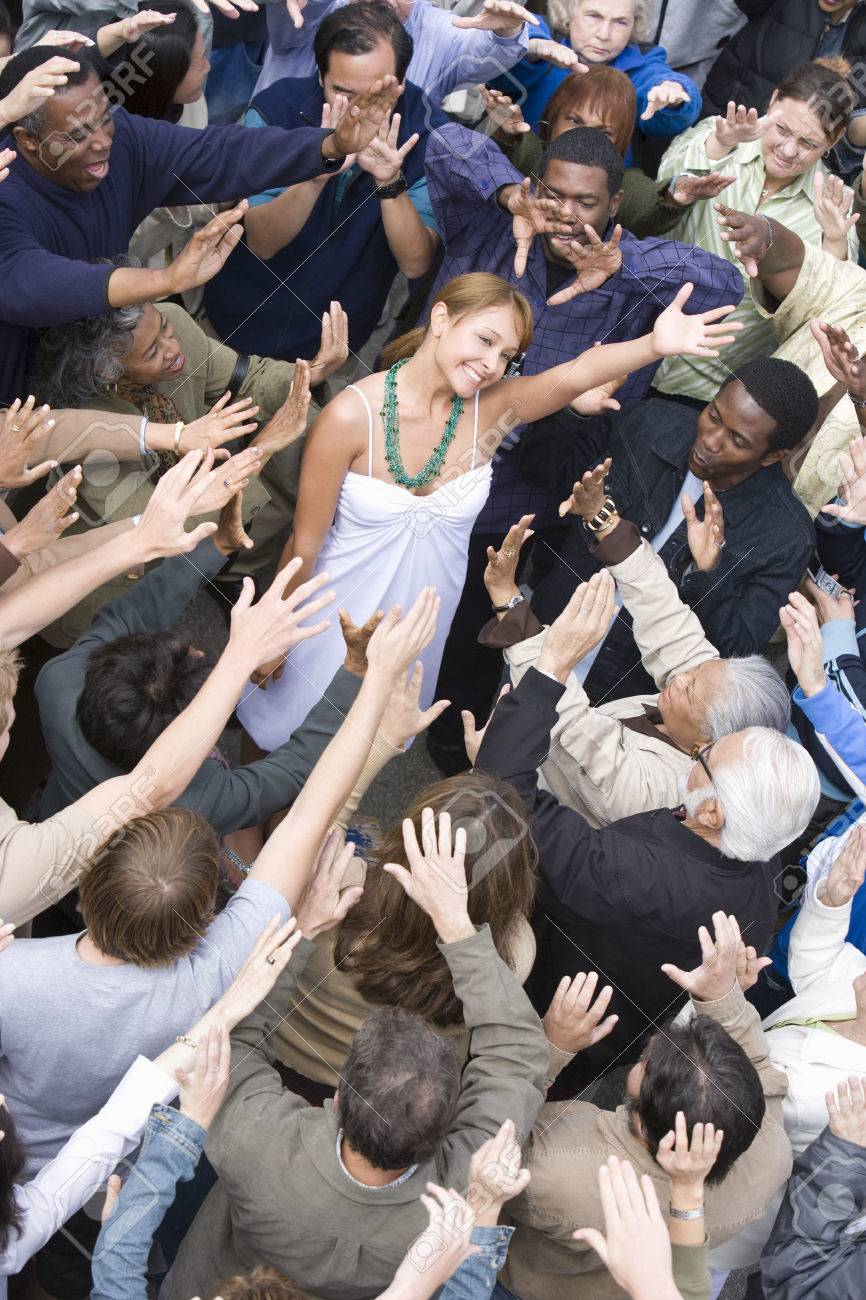 Young woman surrounded by crowd Stock Photo - 5475665