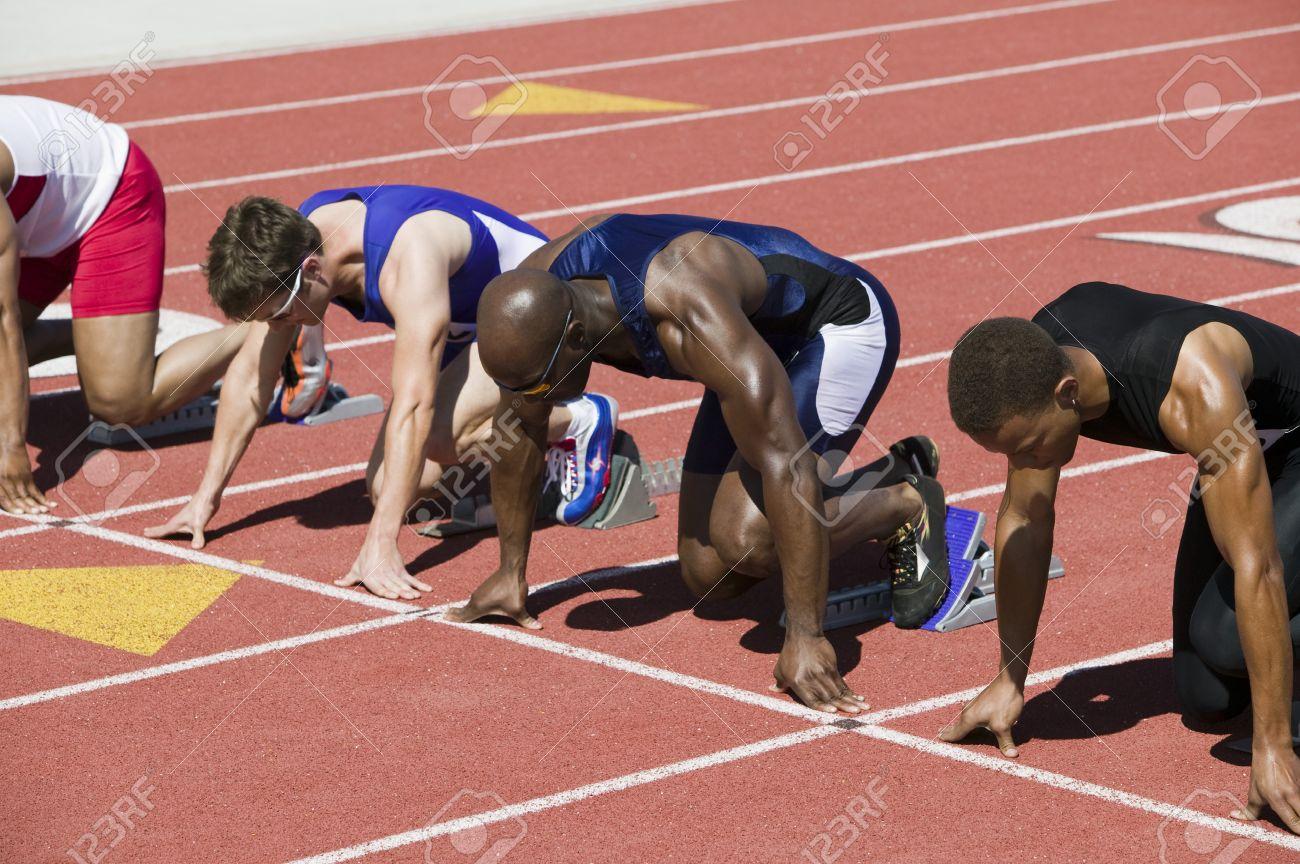 Male sprinters in starting blocks Stock Photo - 5475765