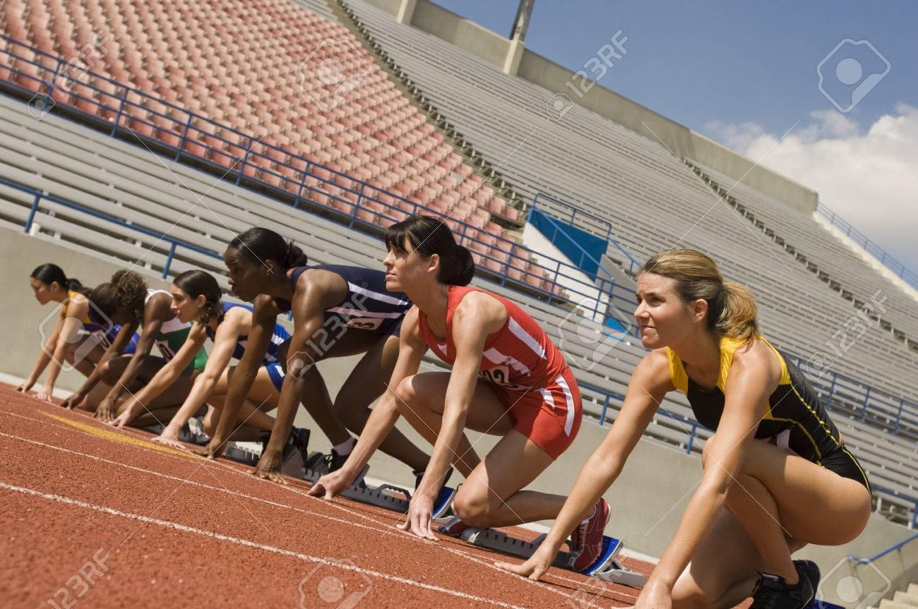 Group of female track athletes on starting blocks Stock Photo - 5475998