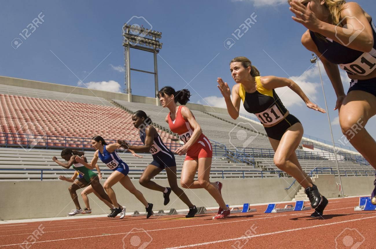 Group of female track athletes sprinting Stock Photo - 5476000