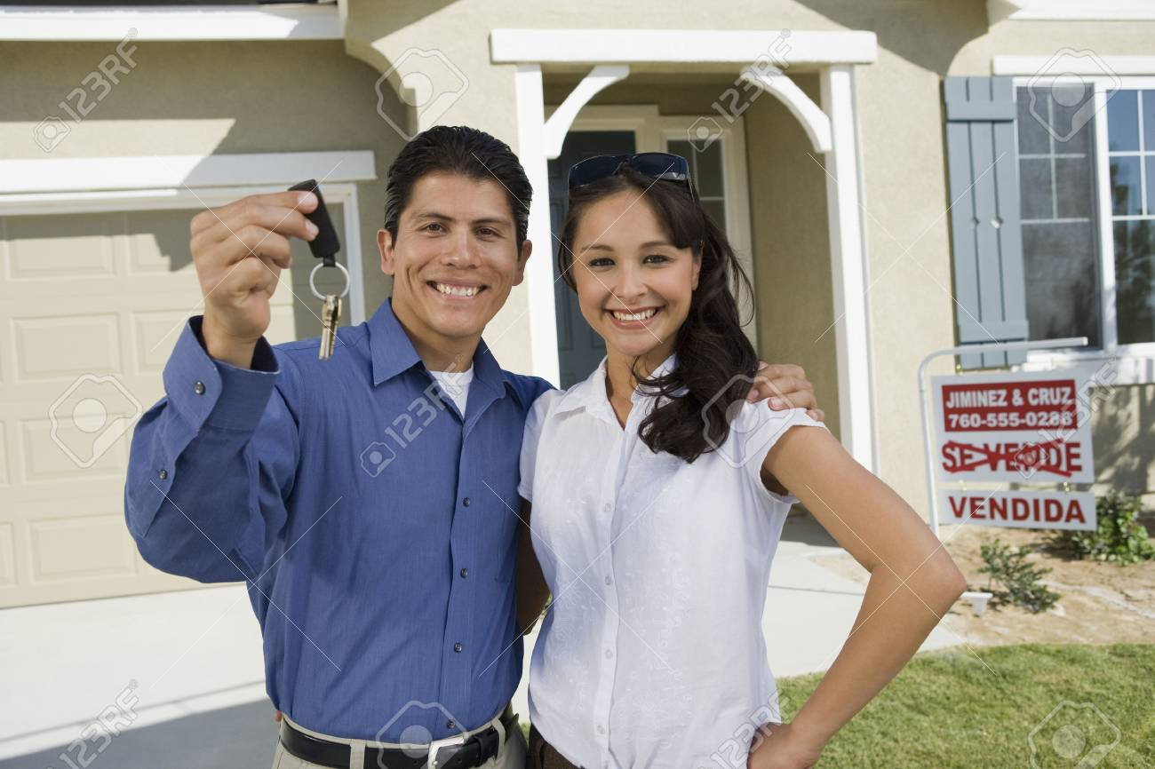 Young couple holding keys outside new home, portrait Stock Photo - 5476151