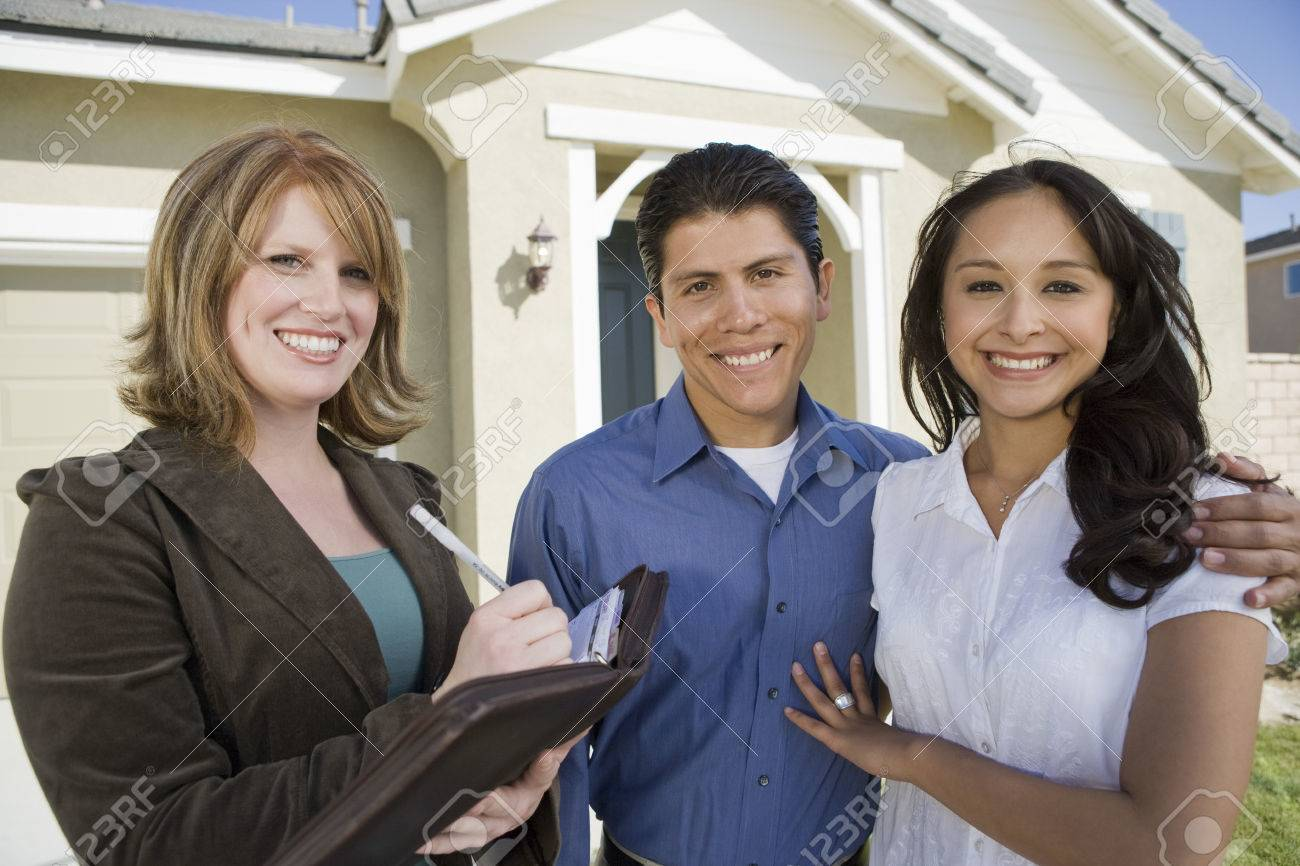 Young couple buying house, signing contract Stock Photo - 5476153