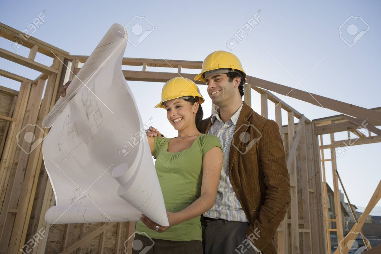 Young couple examining blueprint in construction site Stock Photo - 5476183