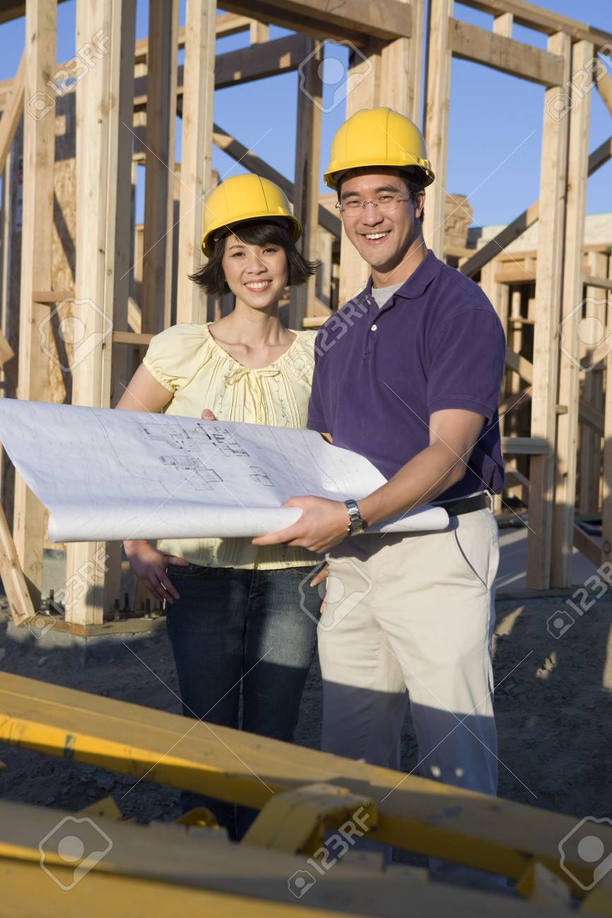 Young couple in construction site Stock Photo - 5476204