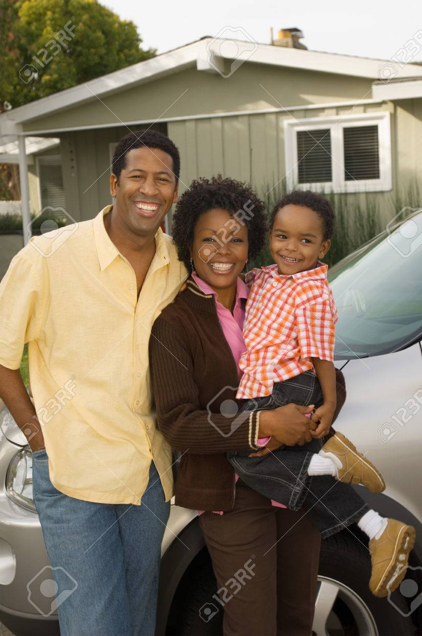 Family Standing in Front of Home Stock Photo - 5476427