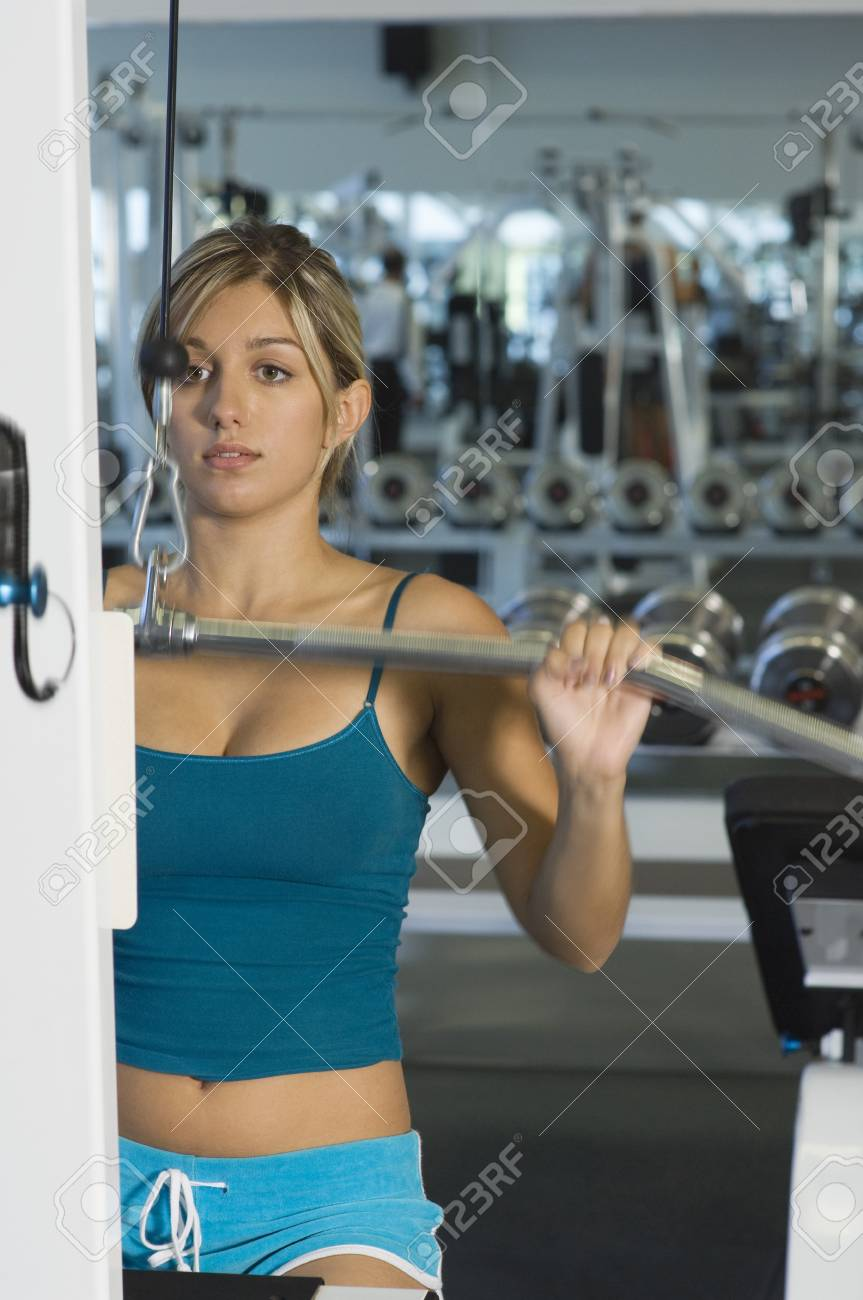 Young Woman Working Out on Weightlifting Machine Stock Photo - 5478262